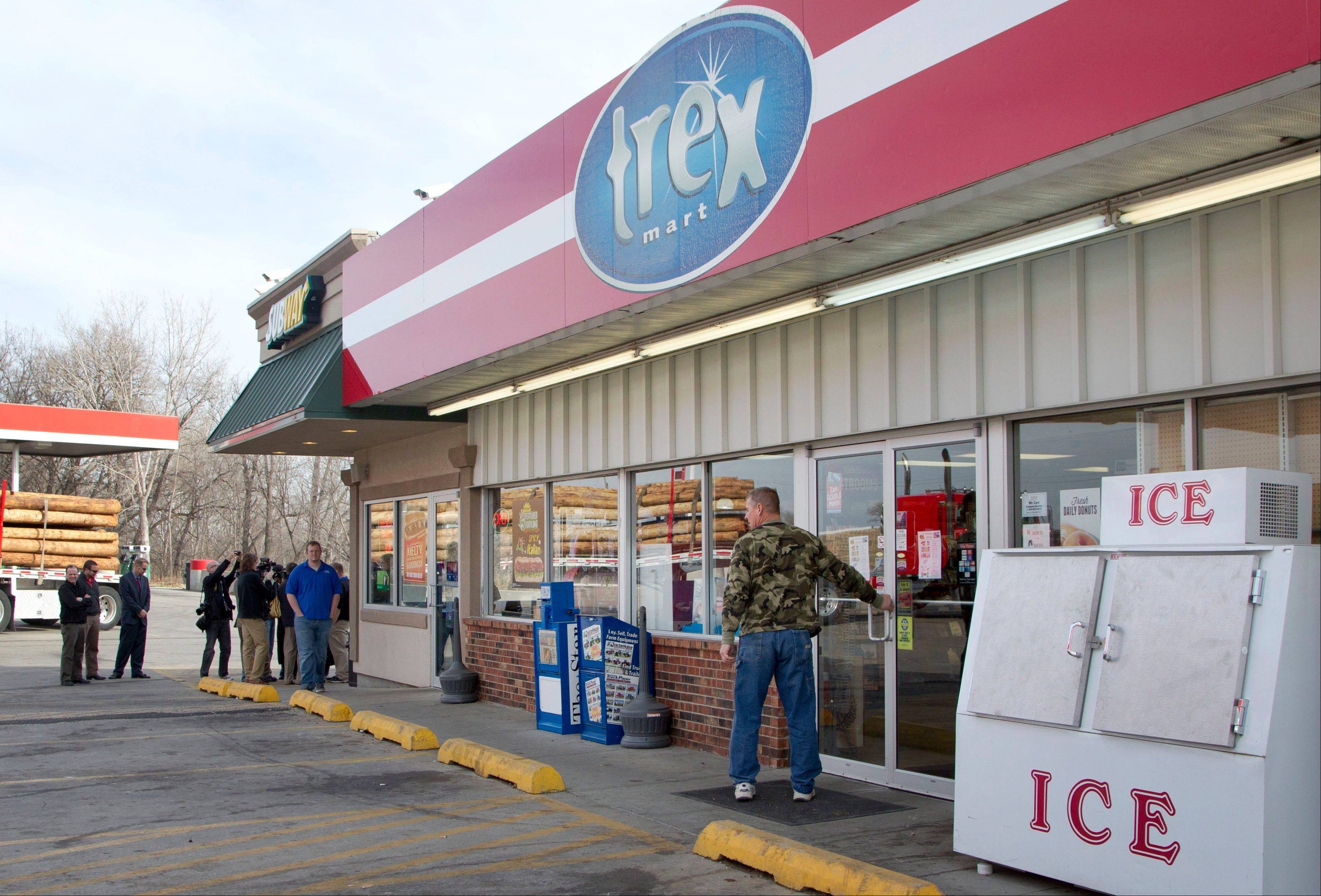 A customer enters Trex Mart as members of the news media gather in Dearborn, Mo., Thursday, Nov. 29, 2012. Trex Mart sold one of last night's winning Powerball tickets.
