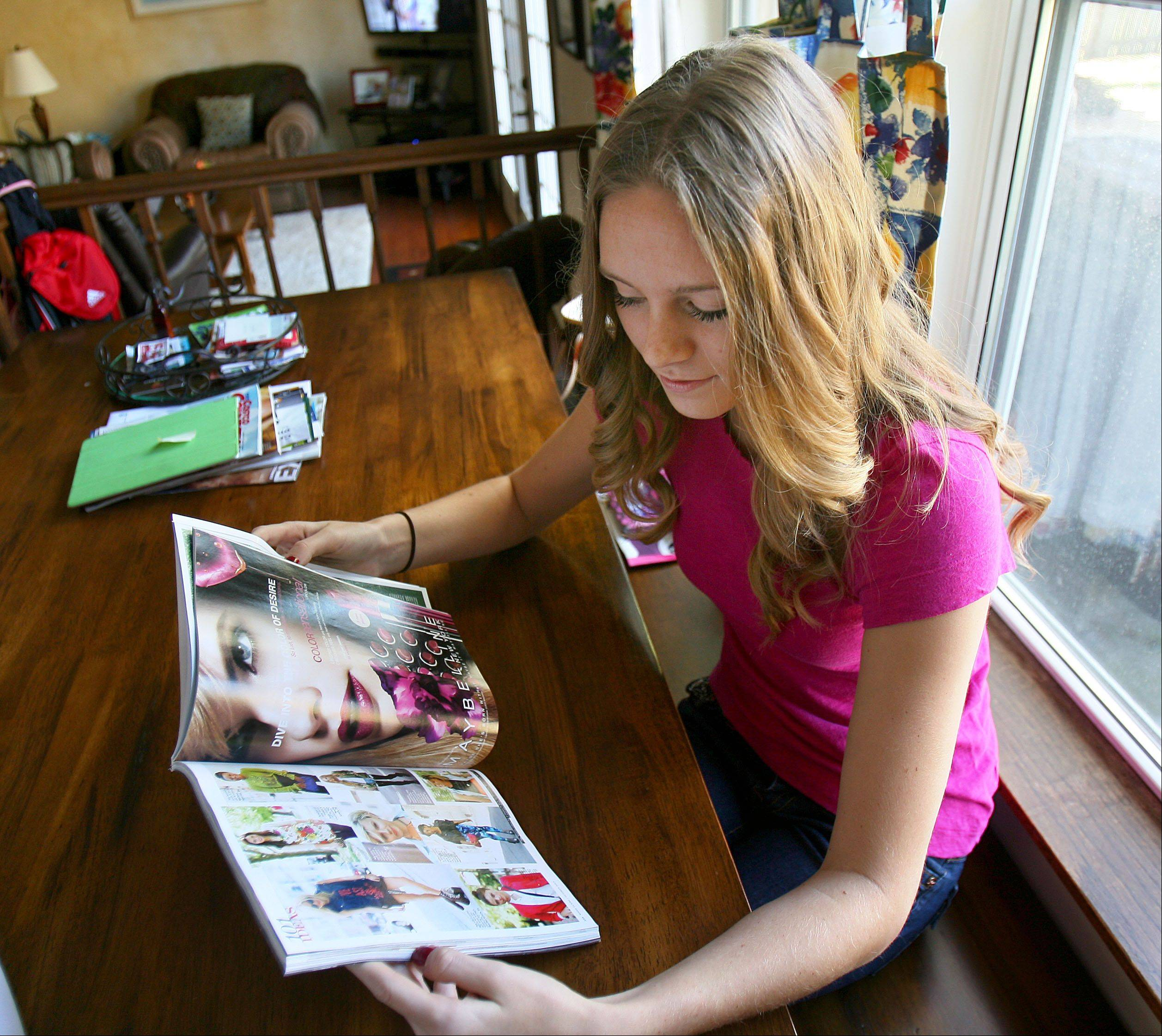 Stevie Finedore, 18, thumbs through an edition of Marie Claire magazine that featured her. The Lake Zurich High School senior is one of the modeling industry's freshest faces and already a runway fixture at New York Fashion Week.