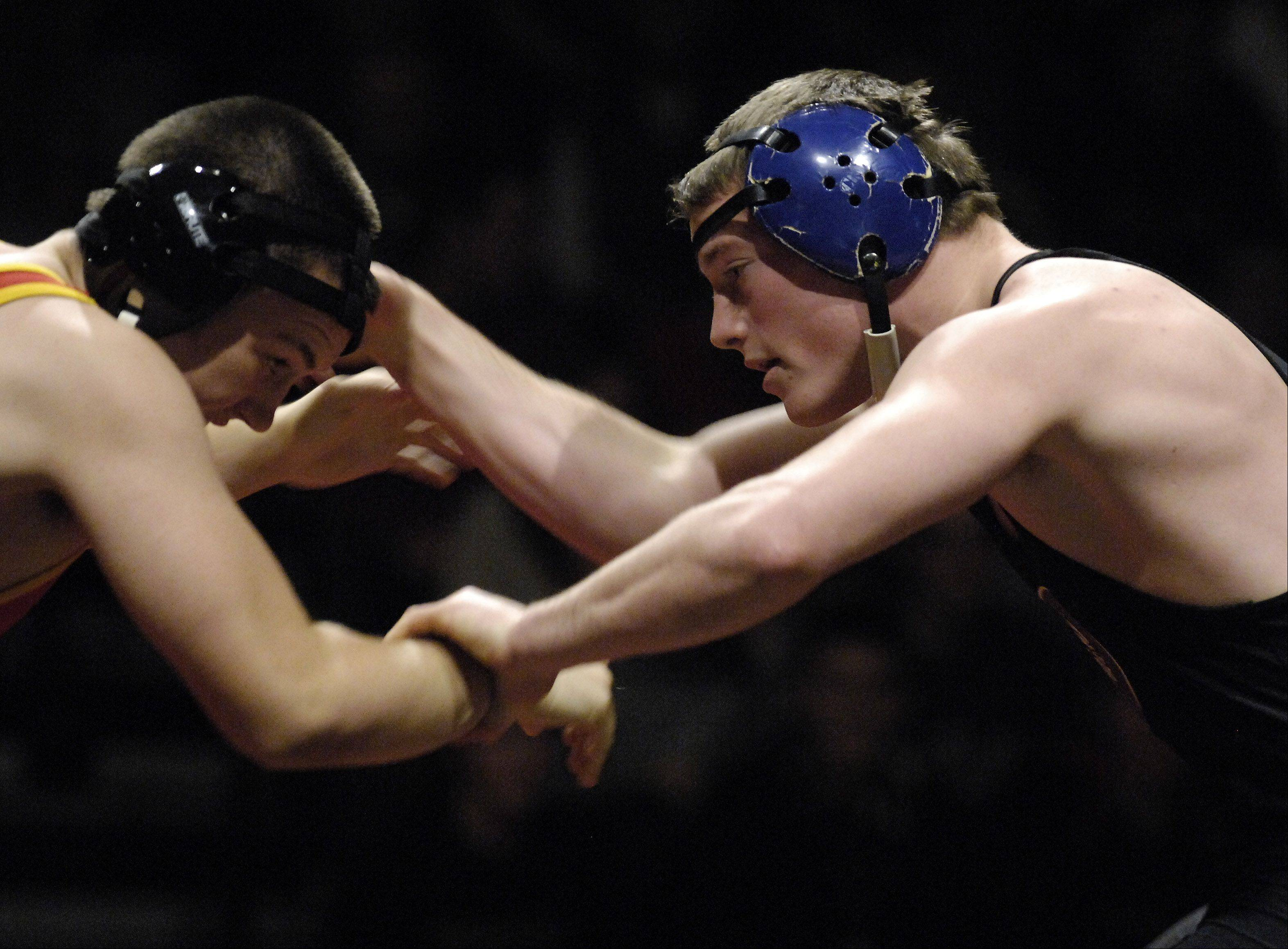 Geneva's Tony Castellvecchi, right, beat Batavia's Nick Offutt at 170 pounds during wrestling action Thursday at Batavia.