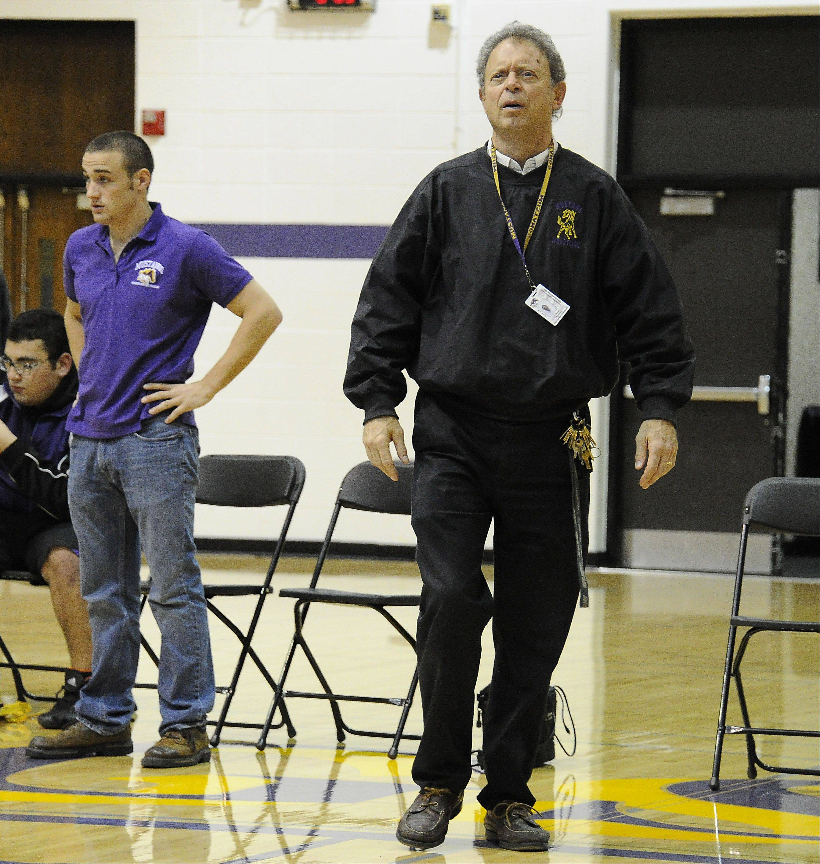 Dave Froelich is in his 35th season of coaching Rolling Meadows wrestling.