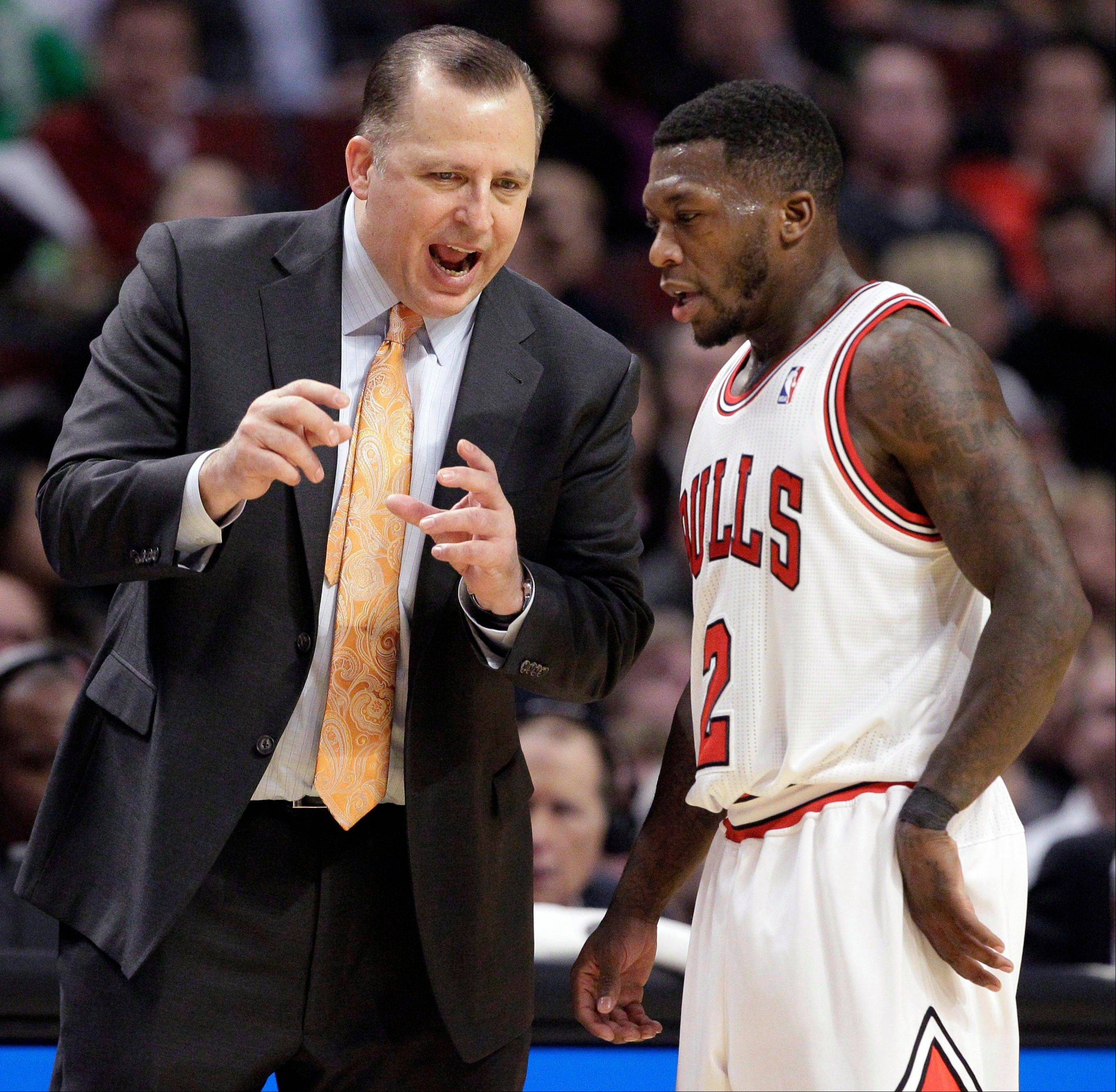 Chicago Bulls coach Tom Thibodeau talks to Nate Robinson during the second half of an NBA basketball game against the Dallas Mavericks in Chicago on Wednesday, Nov. 28, 2012. The Bulls won 101-78.