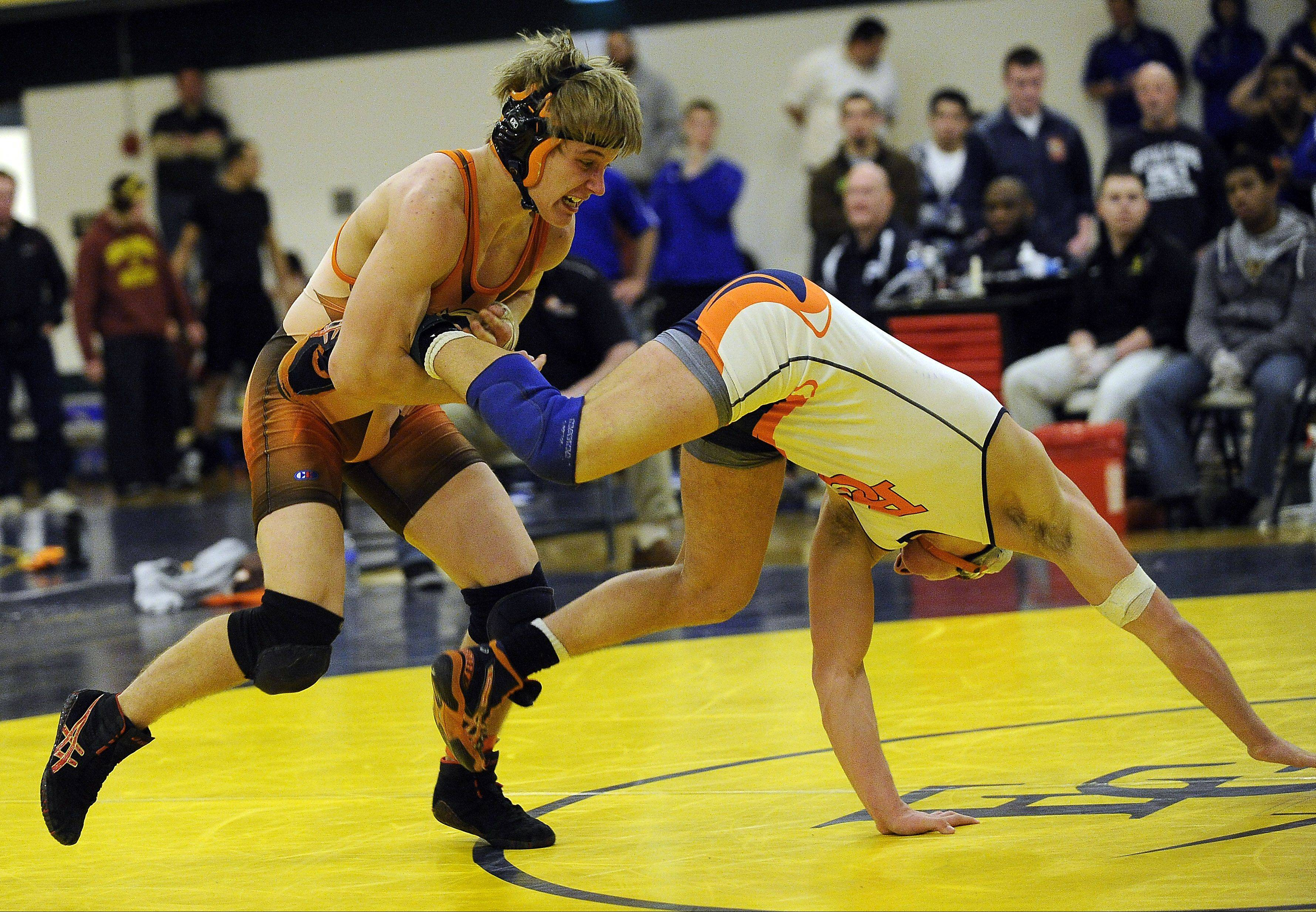 Hersey's Hunter Rollins, left, battles Buffalo Grove's Matt Zabrin at 160 pounds in last season's MSL meet at Elk Grove. Rollins, who placed fifth in the state last year, is back for his senior year; Zabrin is competing at Harper.