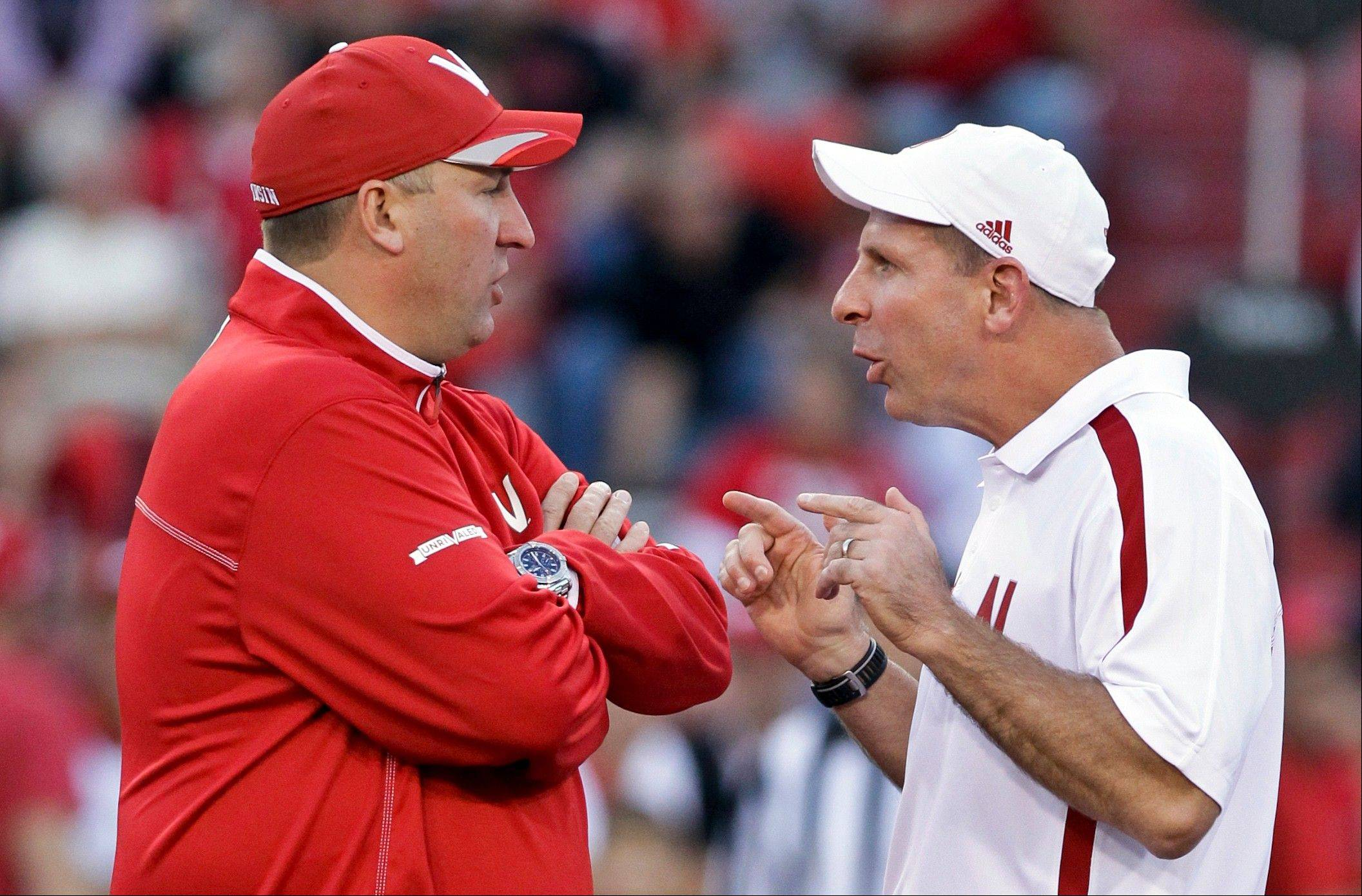 Wisconsin head coach Bret Bielema, left, and Nebraska head coach Bo Pelini chat prior to their game in Lincoln. With Ohio State and Penn State both ineligible for the postseason, though, Wisconsin will represent the Leaders Division in the title game. Wisconsin plays No. 14 Nebraska on Saturday in the Big Ten Championship.