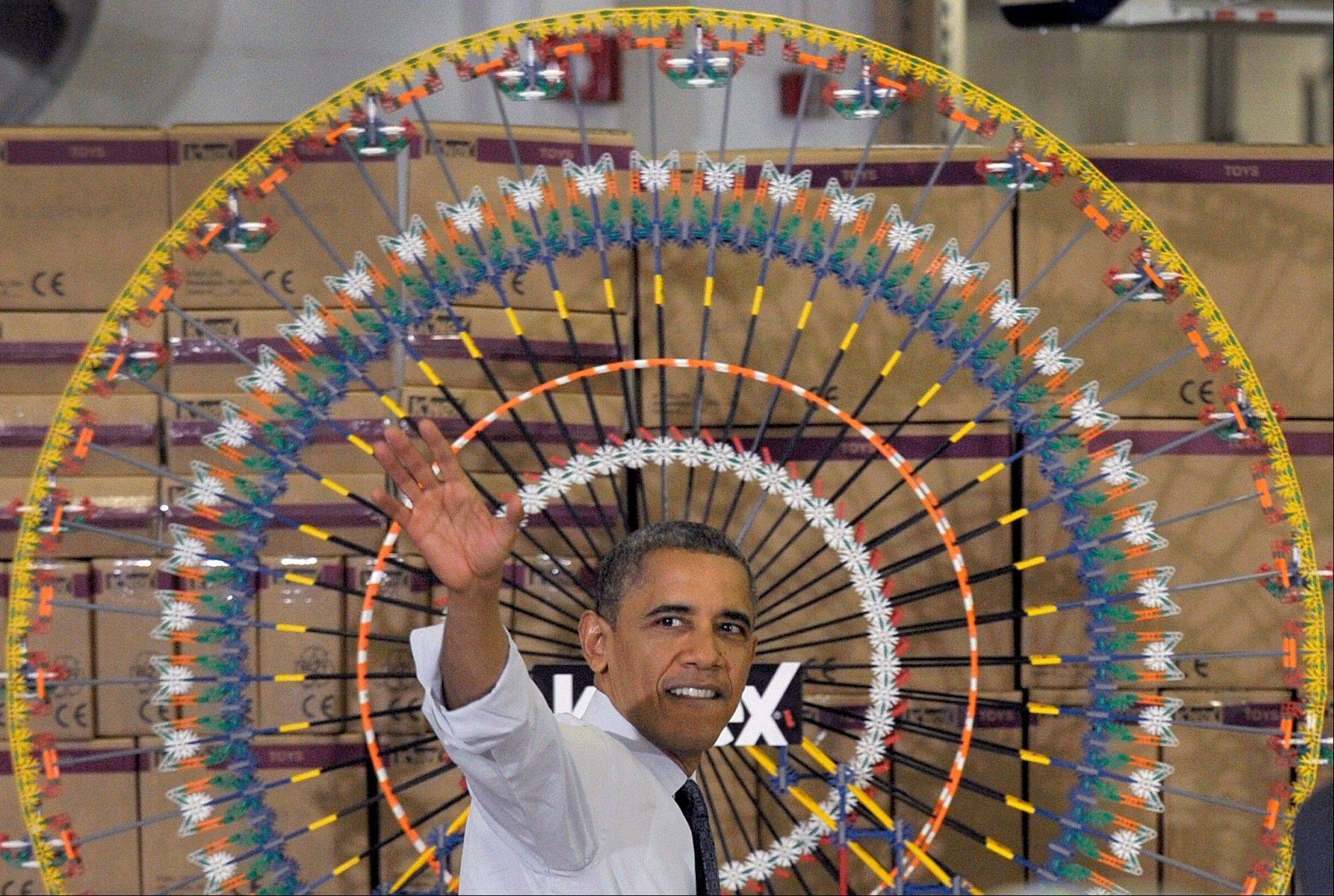 President Barack Obama waves after speaking Friday at the Rodon Group, which manufactures over 95% of the parts for K�NEX Brands toys, in Hatfield, Pa. The visit comes as the White House continues a week of public outreach efforts, while also attempting to negotiate a deal with congressional leaders.