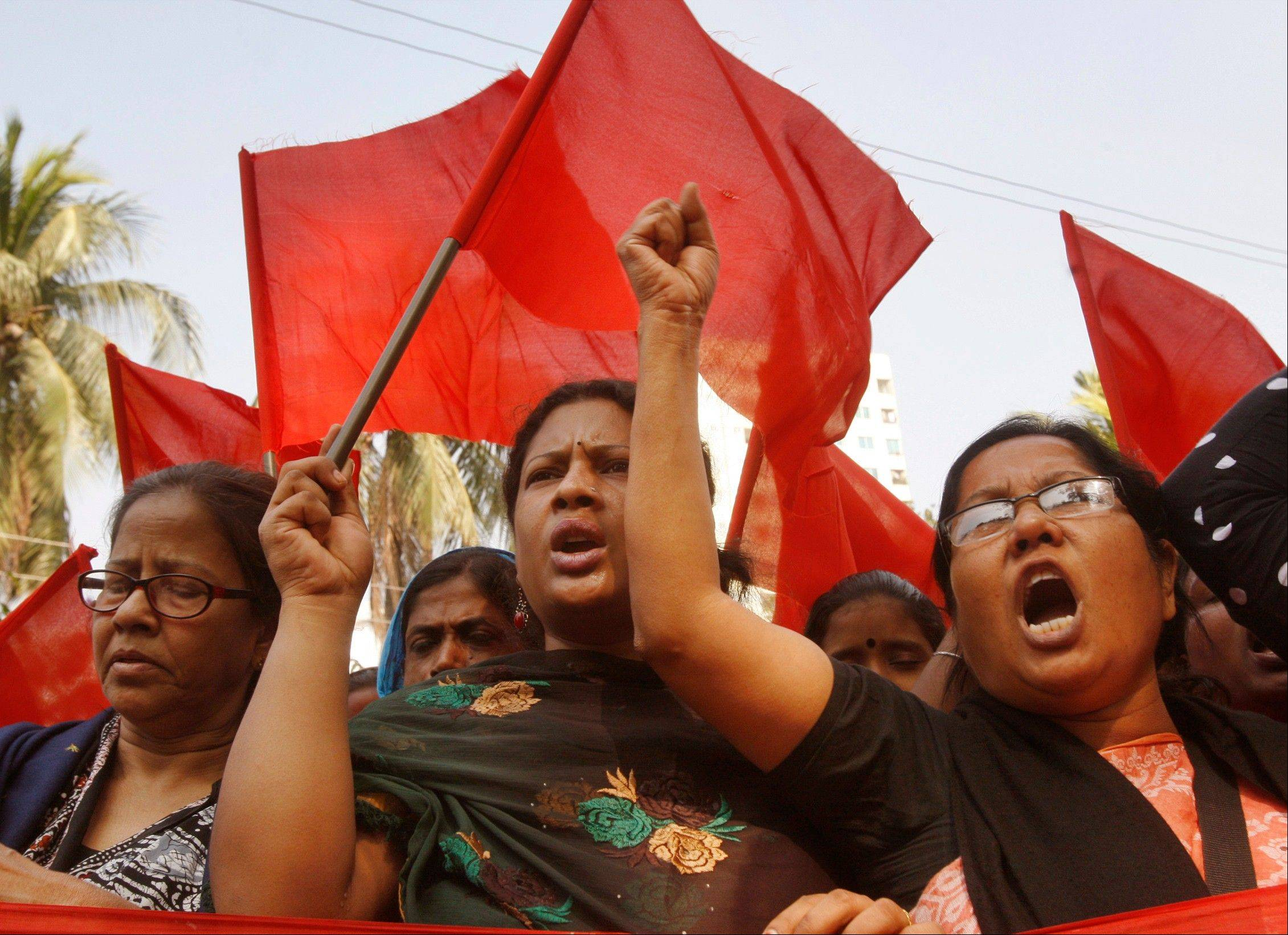 Bangladeshi garment workers shout slogans as they participate in a protest to mourn the death of the victims of a fire in a garment factory in Dhaka, Bangladesh.