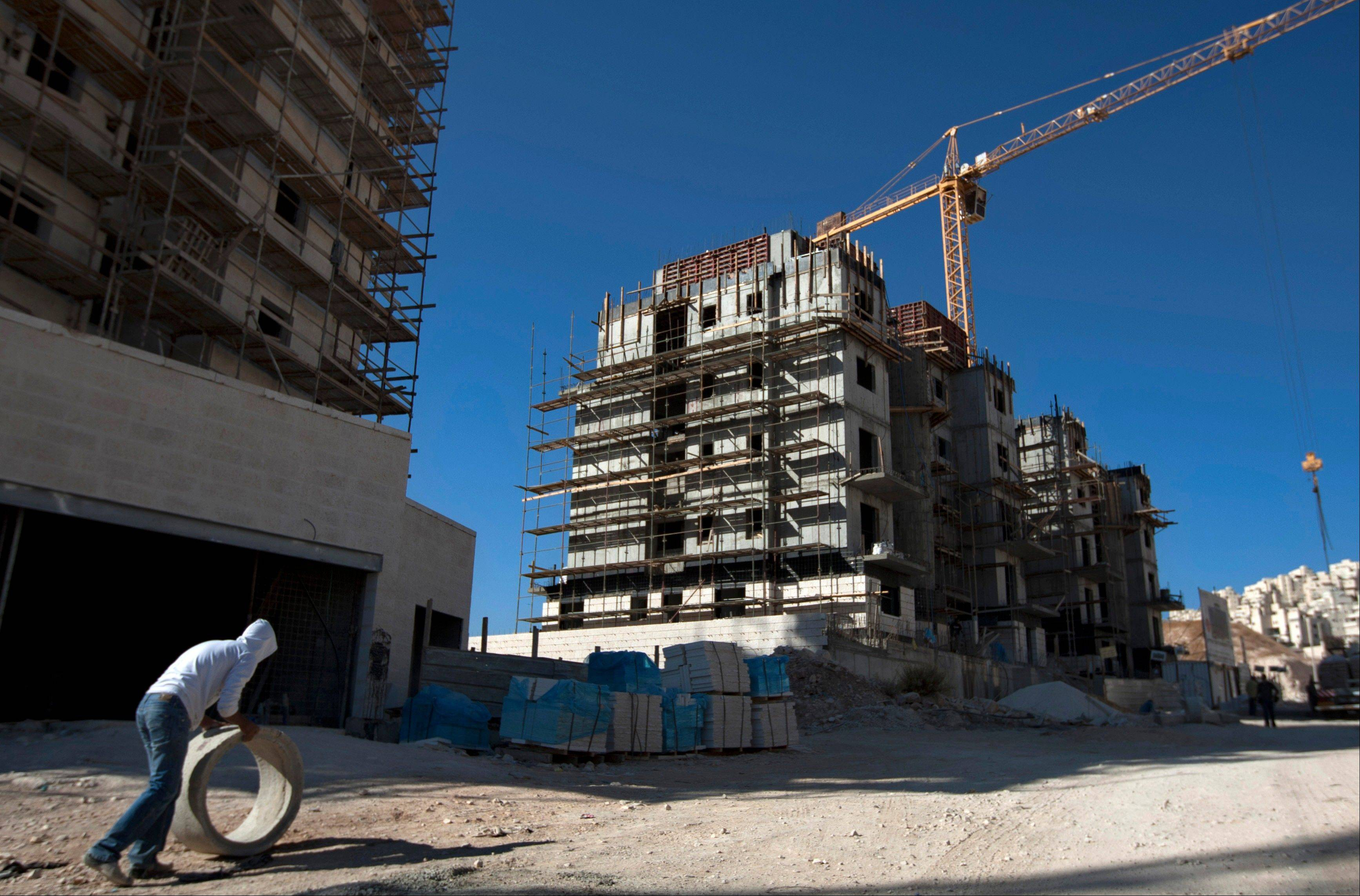 Associated Press/Nov. 2, 2011 A construction worker works at a site of a new housing unit in the east Jerusalem neighborhood of Har Homa.