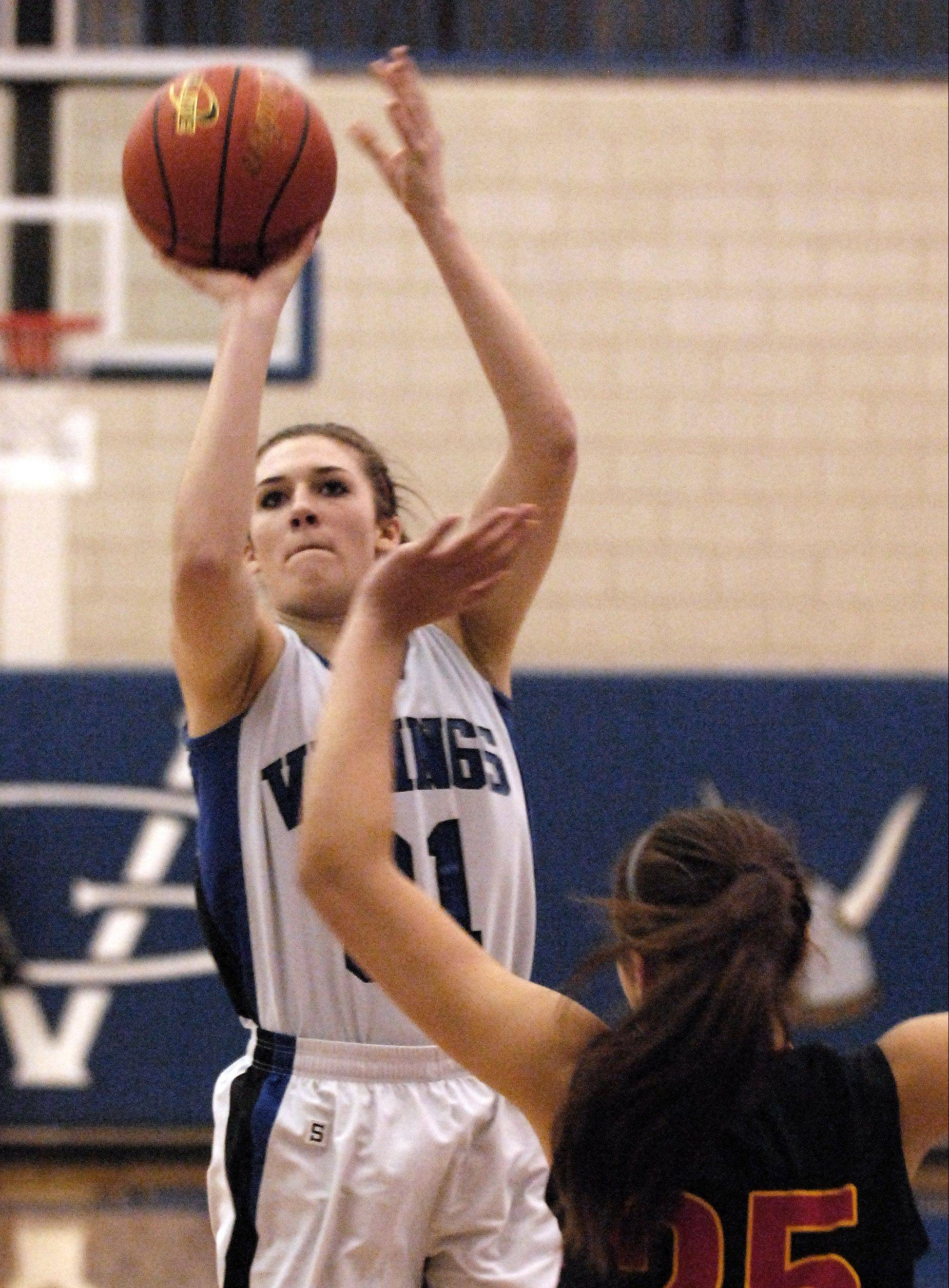 Geneva�s Sami Pawlak puts up a shot over Batavia�s Hanah Frazier Friday at Geneva.