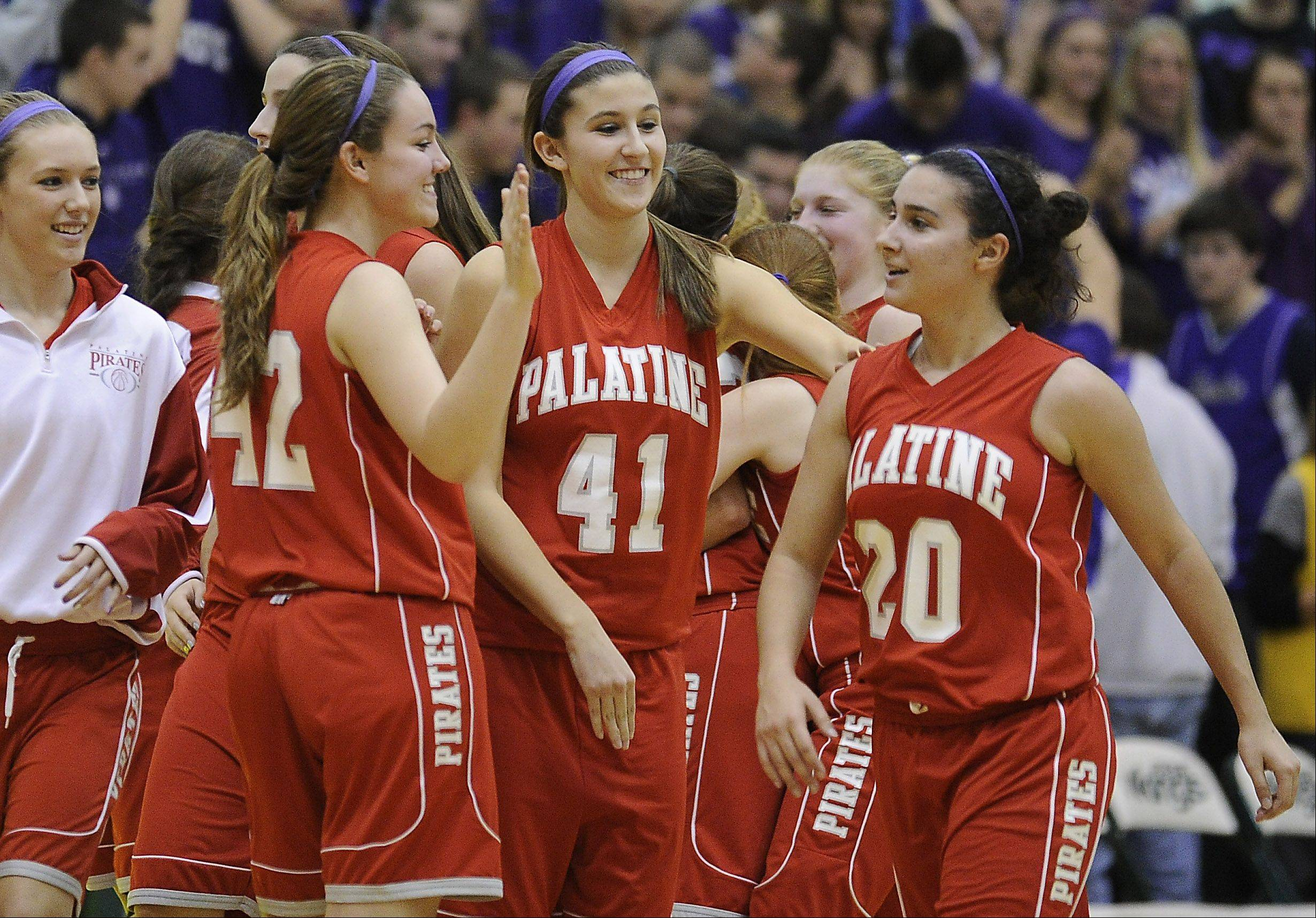 Palatine�s Carrissa Multon, Marissa Masini and Nia Pappas celebrate their victory over Fremd in the girls varsity basketball game at Fremd High School on Friday.
