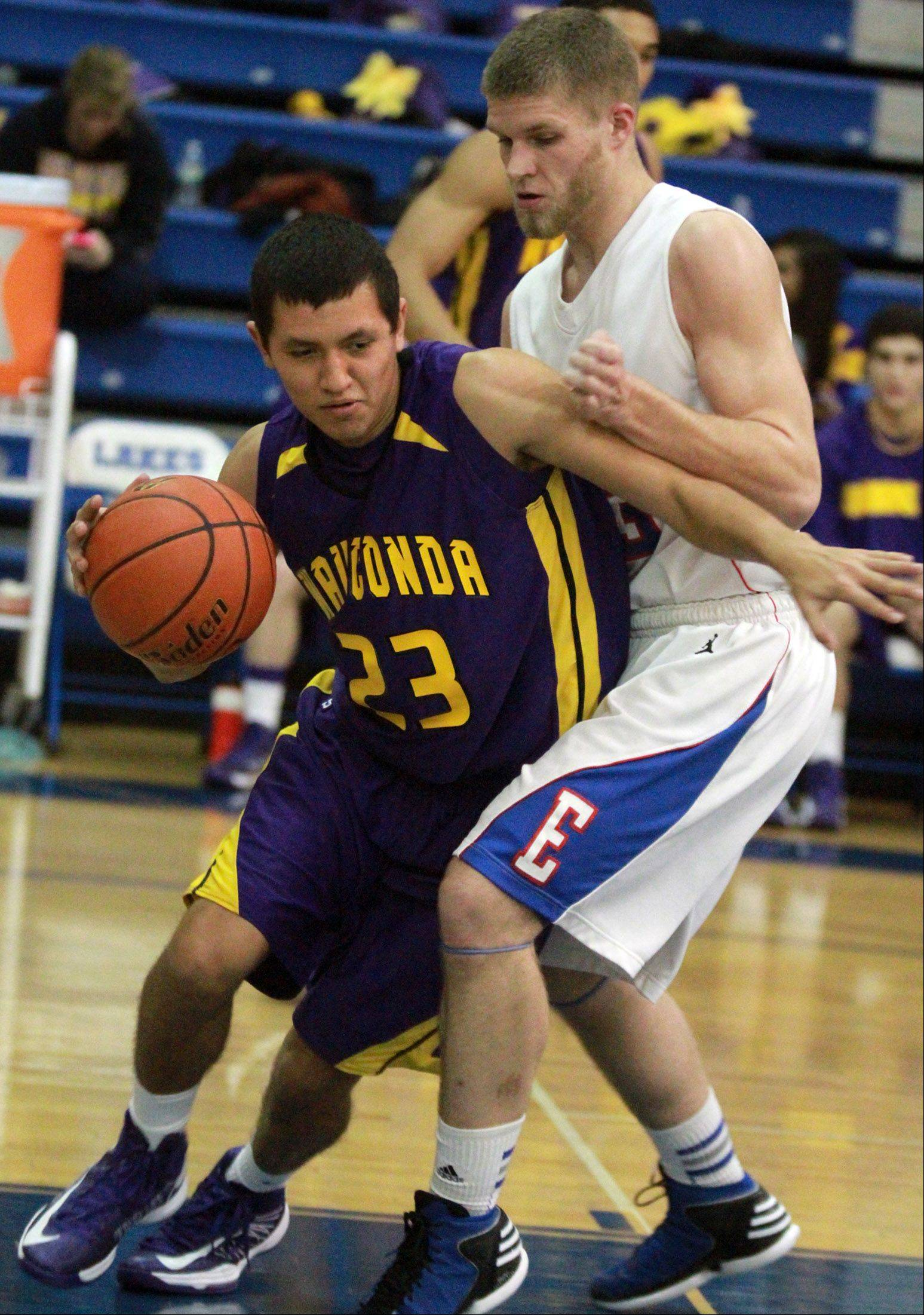 Wauconda�s Kodey Thomas tries to turn the corner against Lakes defender Jake Kohler .