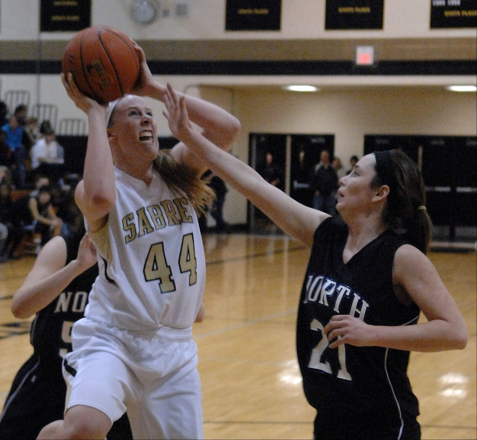 Streamwood�s Hannah McGlone gets a shot off under pressure from St. Charles North�s Alex Silverman in her face.
