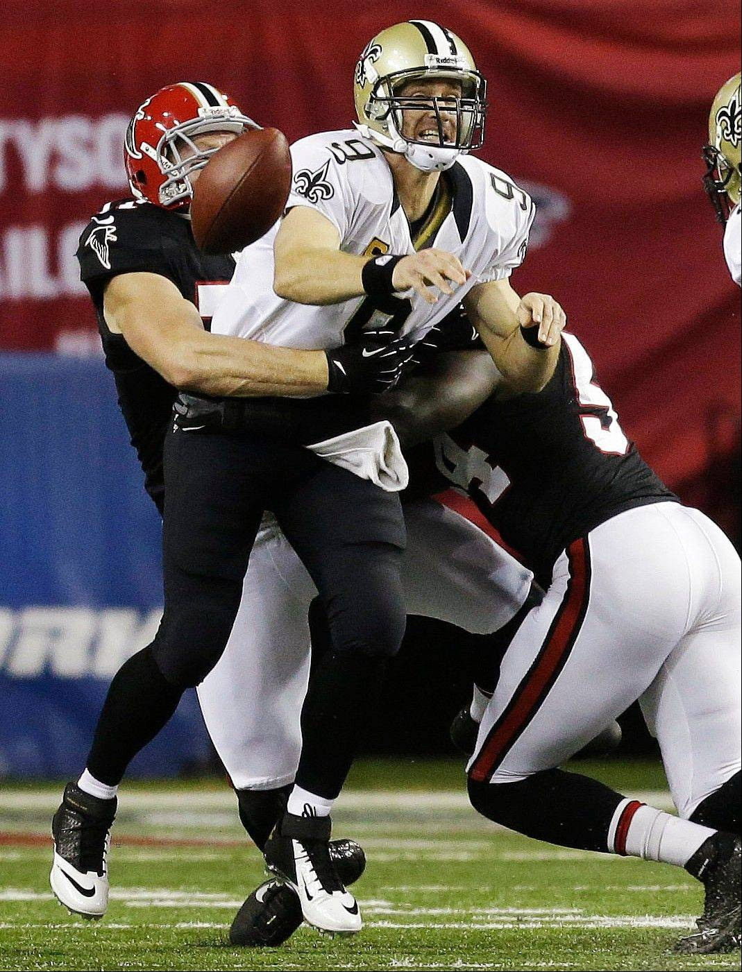 The Atlanta Falcons moved to the brink of clinching a division championship. Drew Brees and the New Orleans Saints wound up with egg on their faces. After racing to a 17-0 lead, the Falcons turned to their defense to make it stand up, picking off five of Brees' passes and ending his NFL-record touchdown streak in a 23-13 victory over the Saints on Thursday night.
