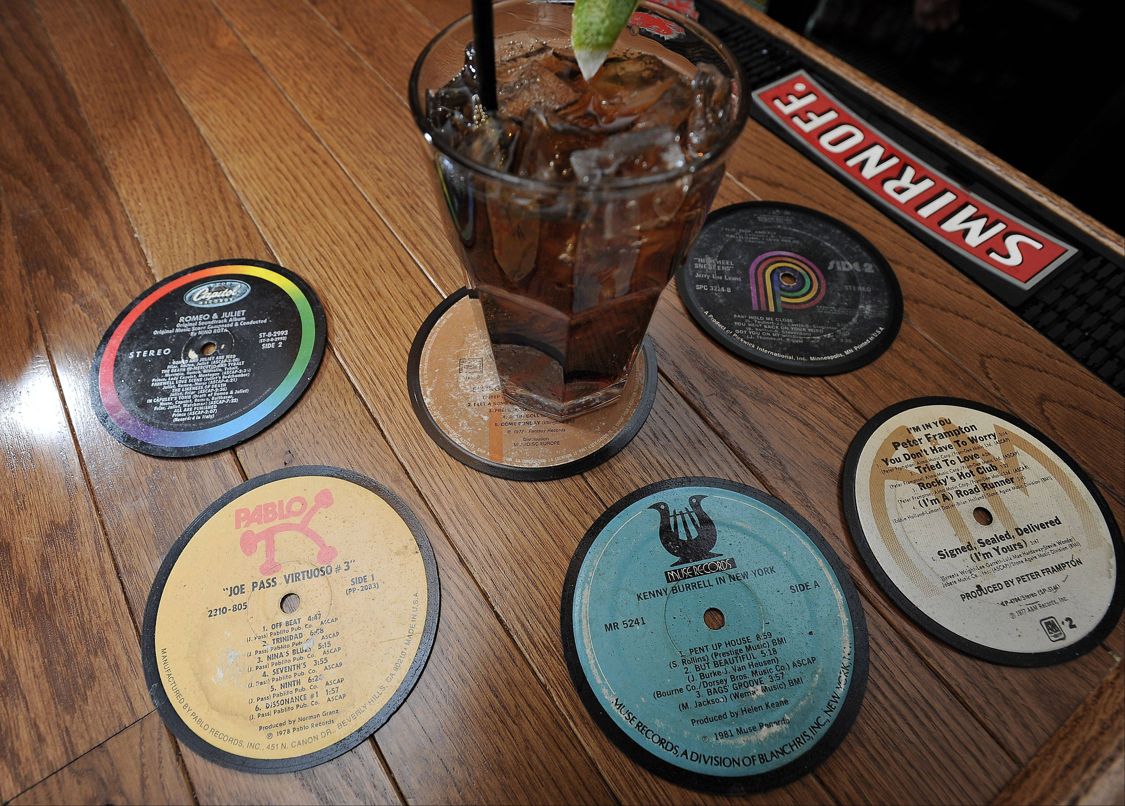 Coasters made from old record albums add to the music-themed decor at Mac's on Slade in Palatine.