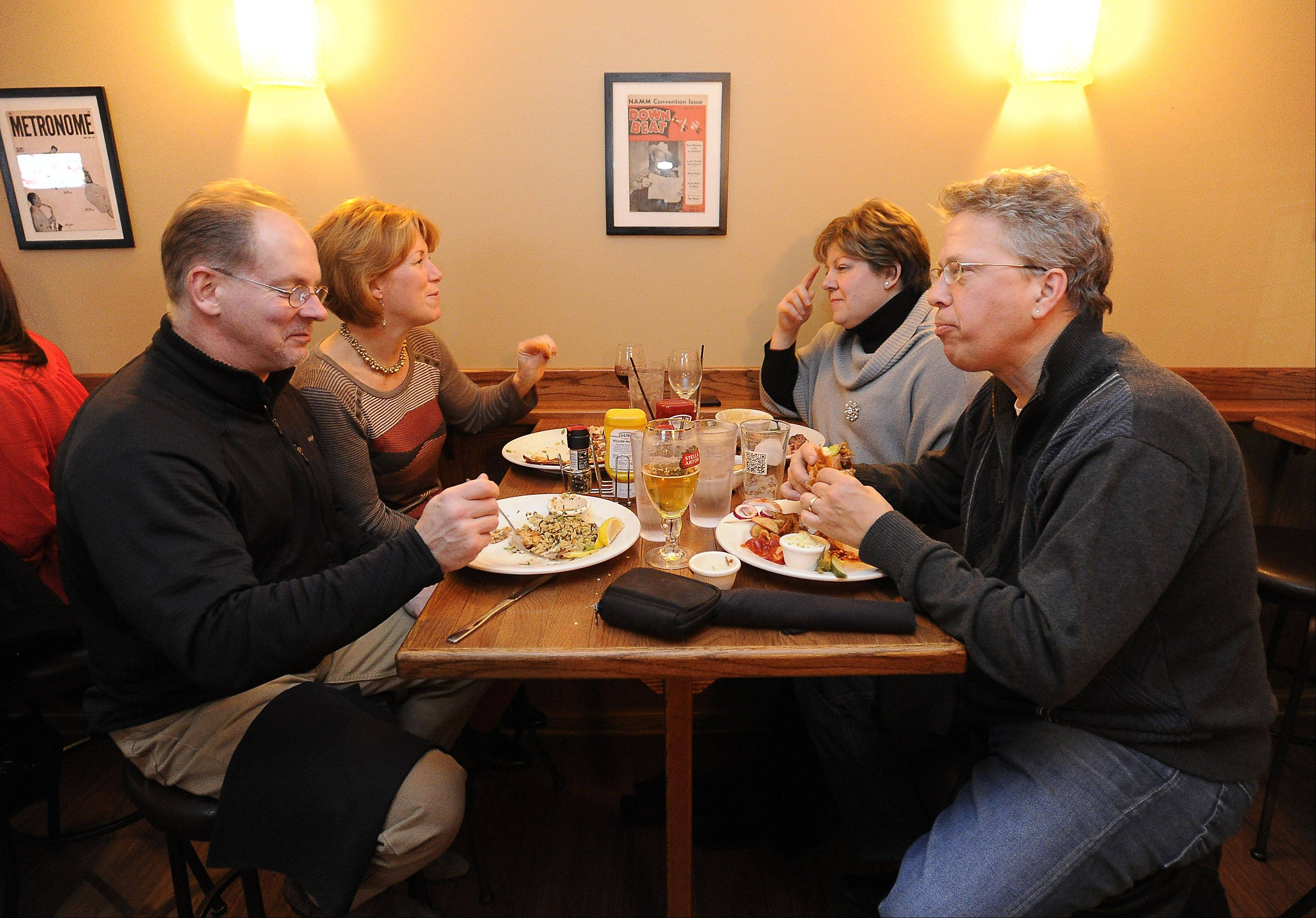 Inverness residents Kurt and Joanne Konrath, right, and Dick and Lisa Laniers enjoy dinner at Mac's on Slade in Palatine.