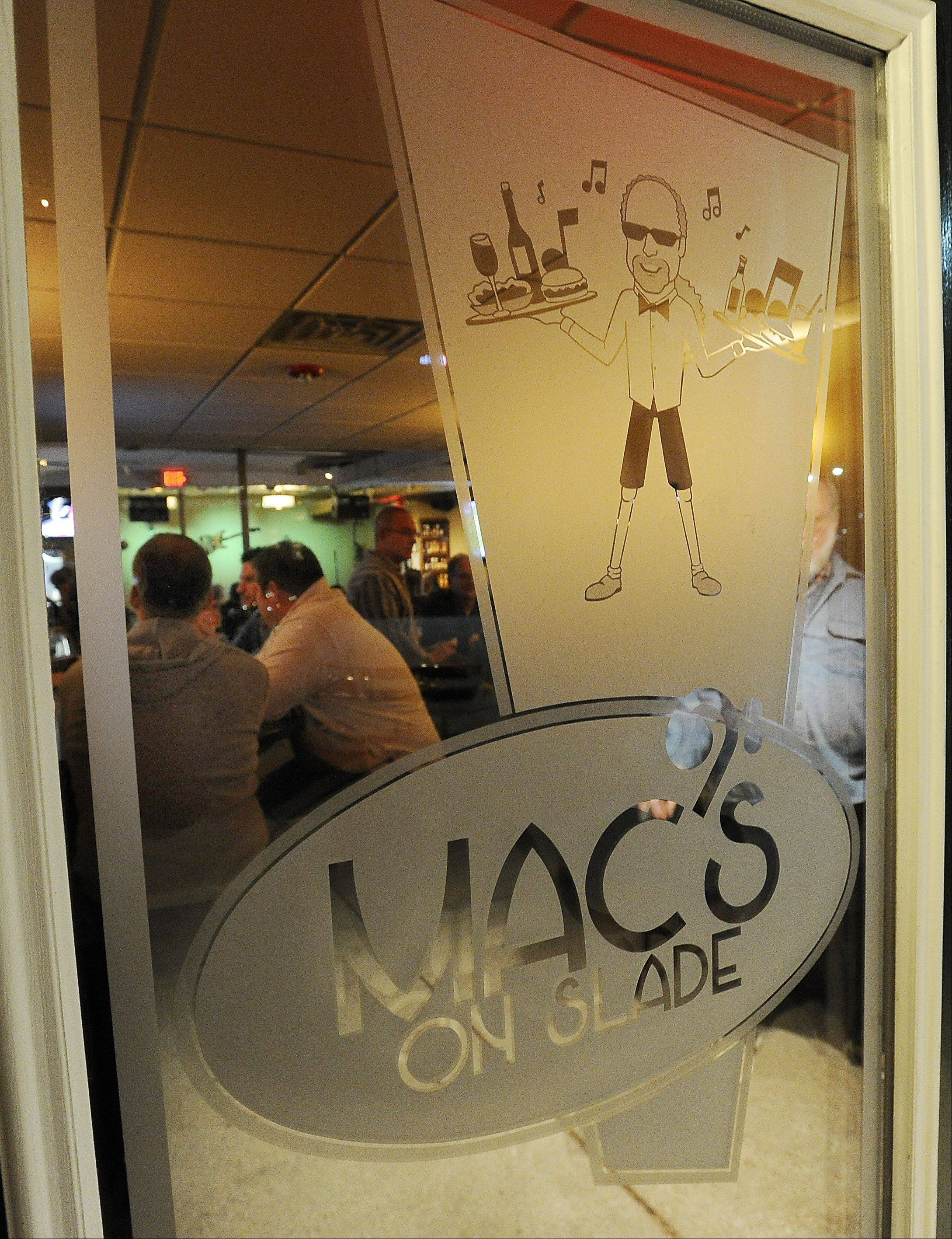 The owner's likeness welcomes patrons to Mac's on Slade, a new music-centric bar in downtown Palatine.