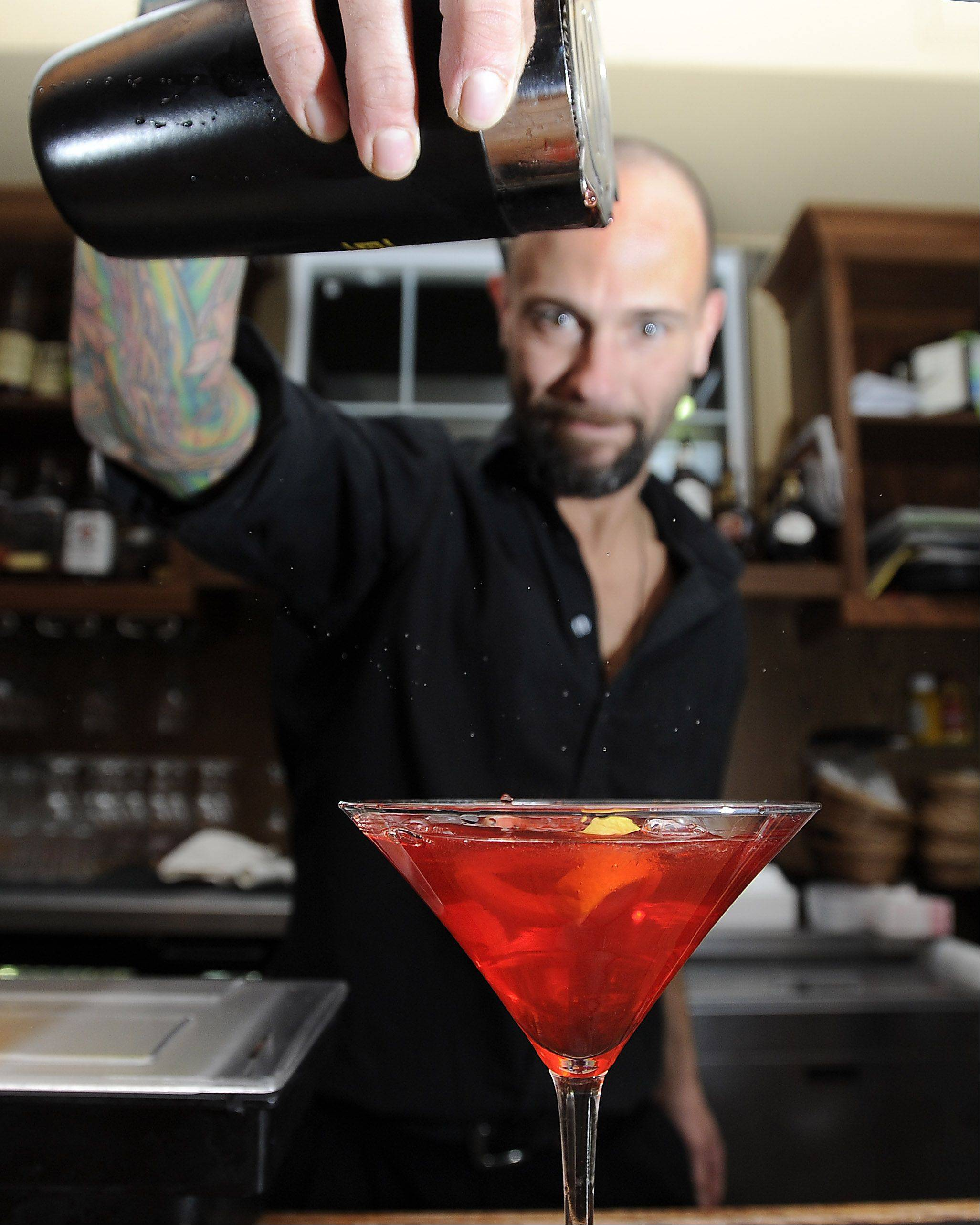 Craig Ribbens mixes a crazy Cosmo for patrons at Mac's on Slade.