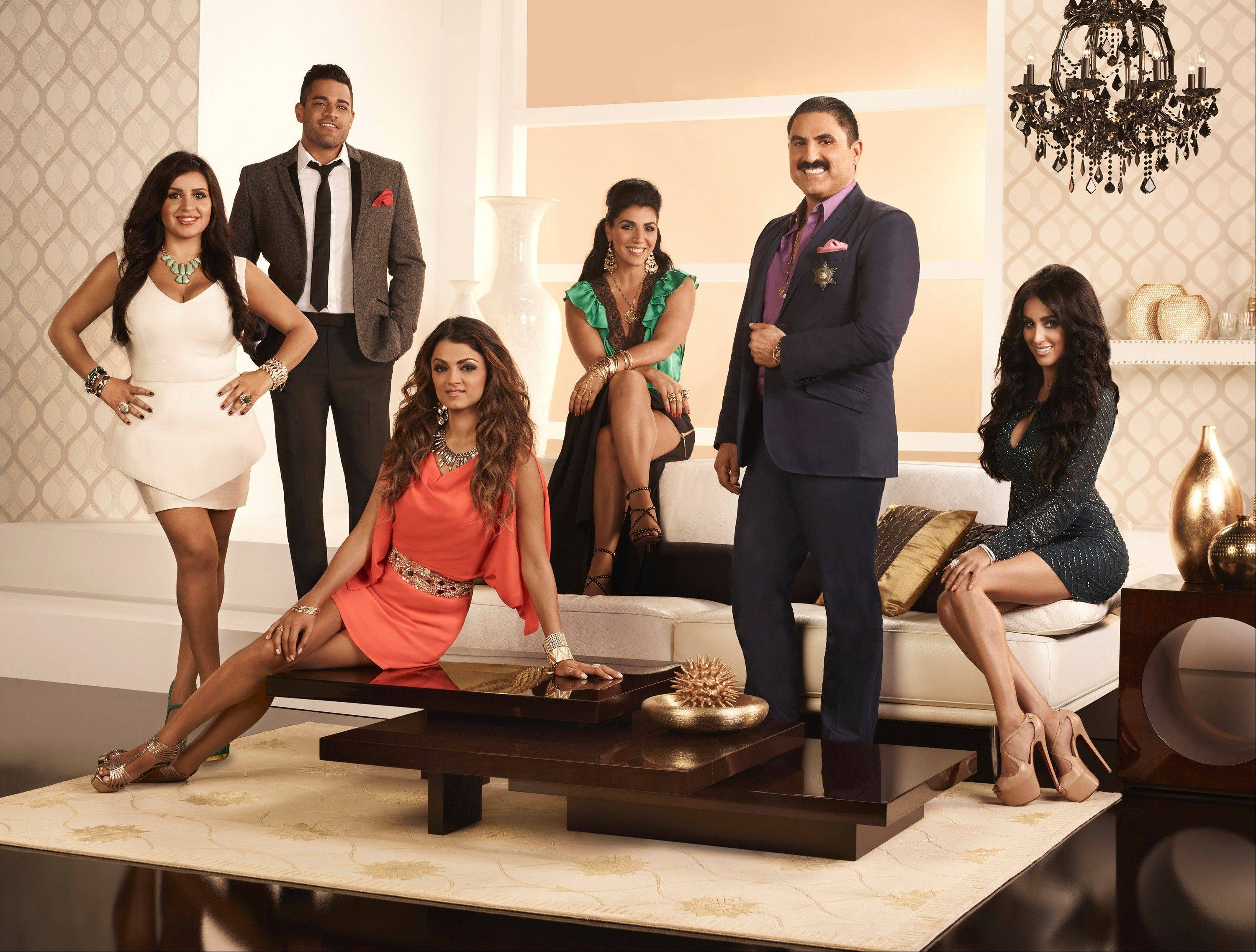 "Bravo's ""Shahs of Sunset"" follows a group of young Iranian-Americans living in L.A. Featured are Mercedes ""MJ"" Javid, left, Mike Shouhed, Golnesa ""GG"" Gharachedaghi, Asa Soltan Rahmati, Reza Farahan and new cast member Lilly Ghalichi."