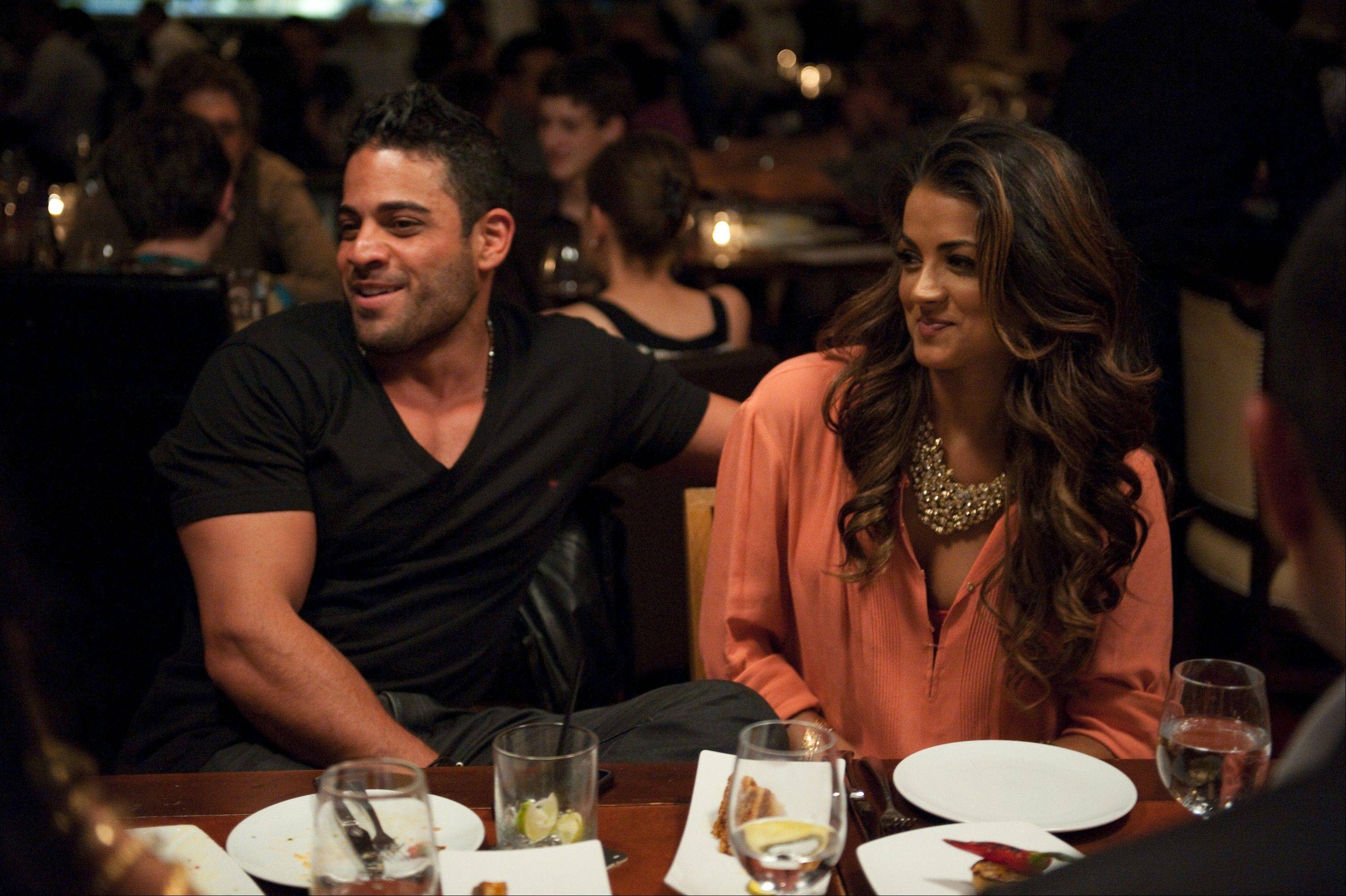 "Friends Mike Shouhed and Golnesa ""GG"" Gharachedaghi enjoy a night out on Bravo's ""Shahs of Sunset."" The reality show, about young Iranian-Americans living in L.A., returns Sunday, Dec. 2."