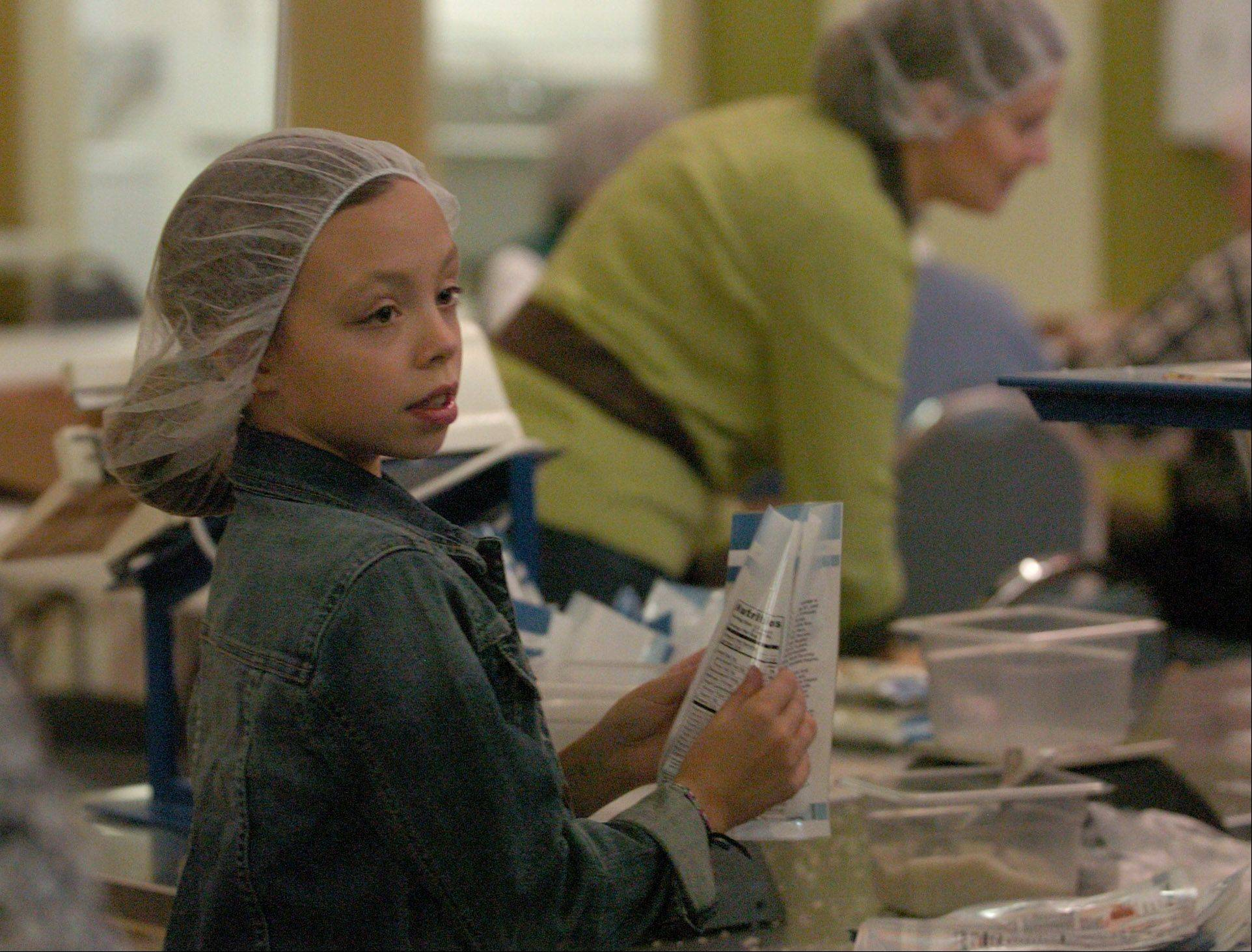 Kaitlyn Weiss of Huntley, a member of the Fox Valley Home Schoolers, packs food at Feed My Starving Children in Schaumburg.