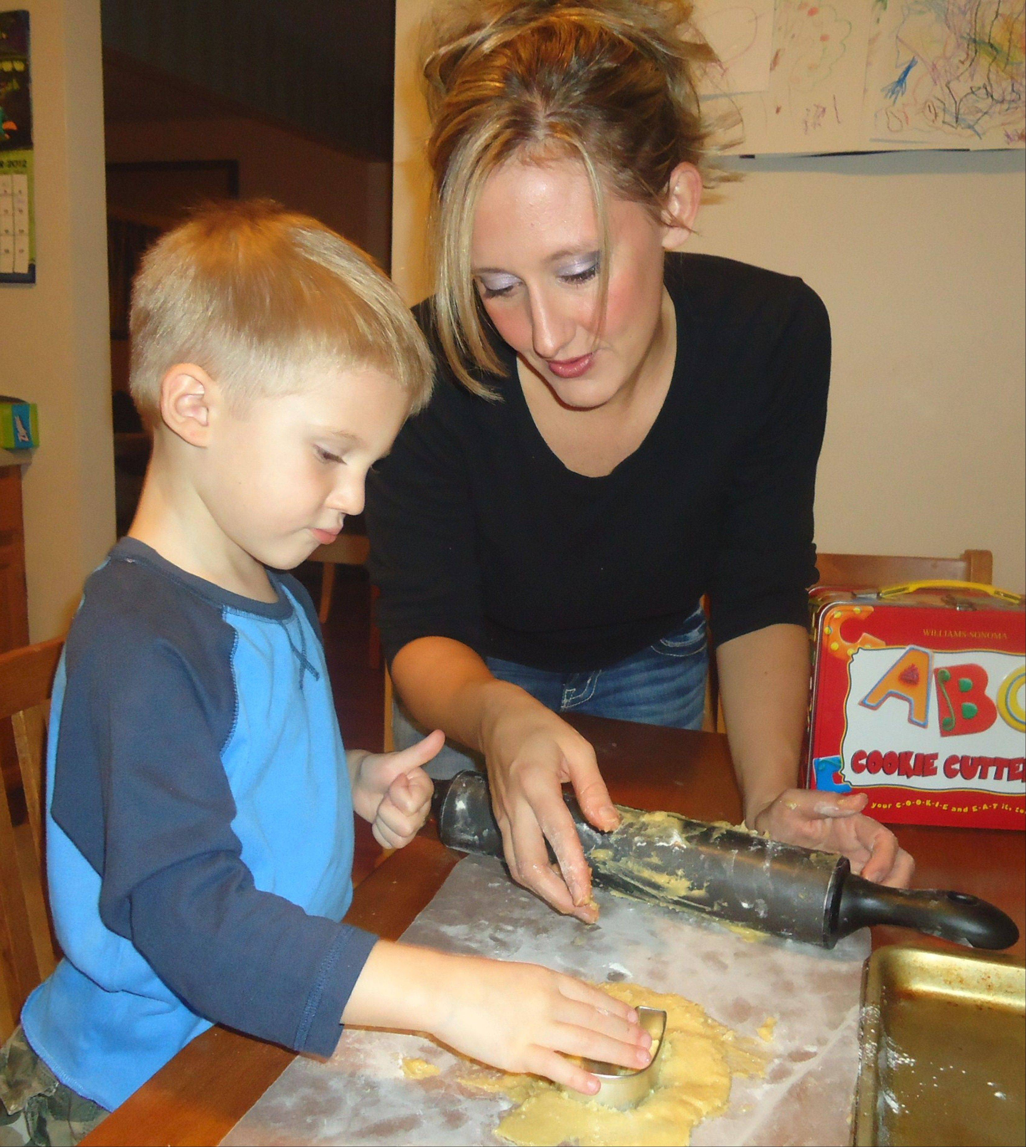 Volunteering and giving to others has been a way of life for Jennifer Ubert of Palatine, and she's passing the tradition along to her son, Ryan, 3. Here, they make cookies to benefit Relay For Life.