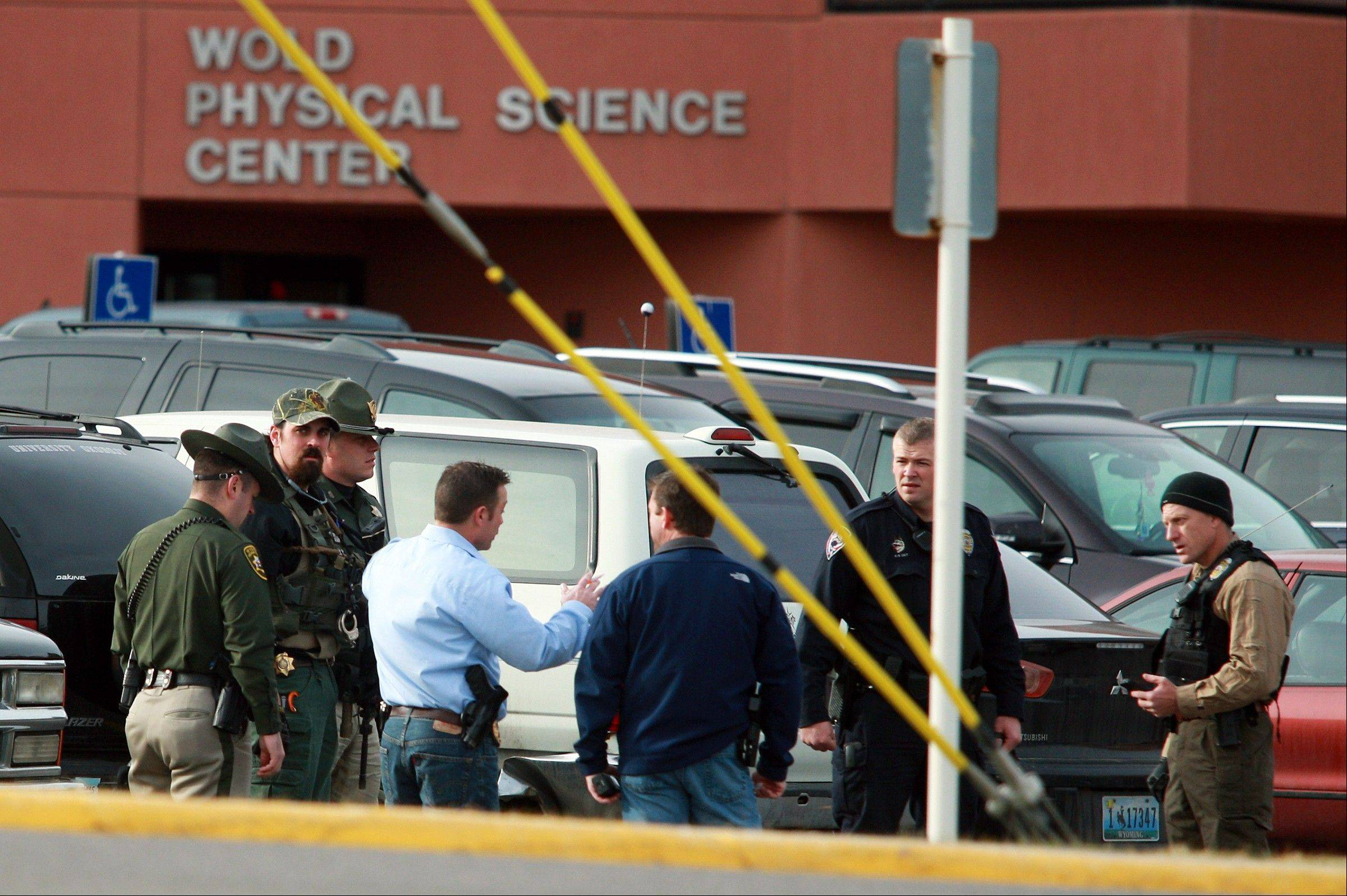 Associated PressLaw enforcement officers from various agencies prepare to sweep the Wold Physical Science Center Friday after a reported homicide at Casper College in Casper, Wyo.