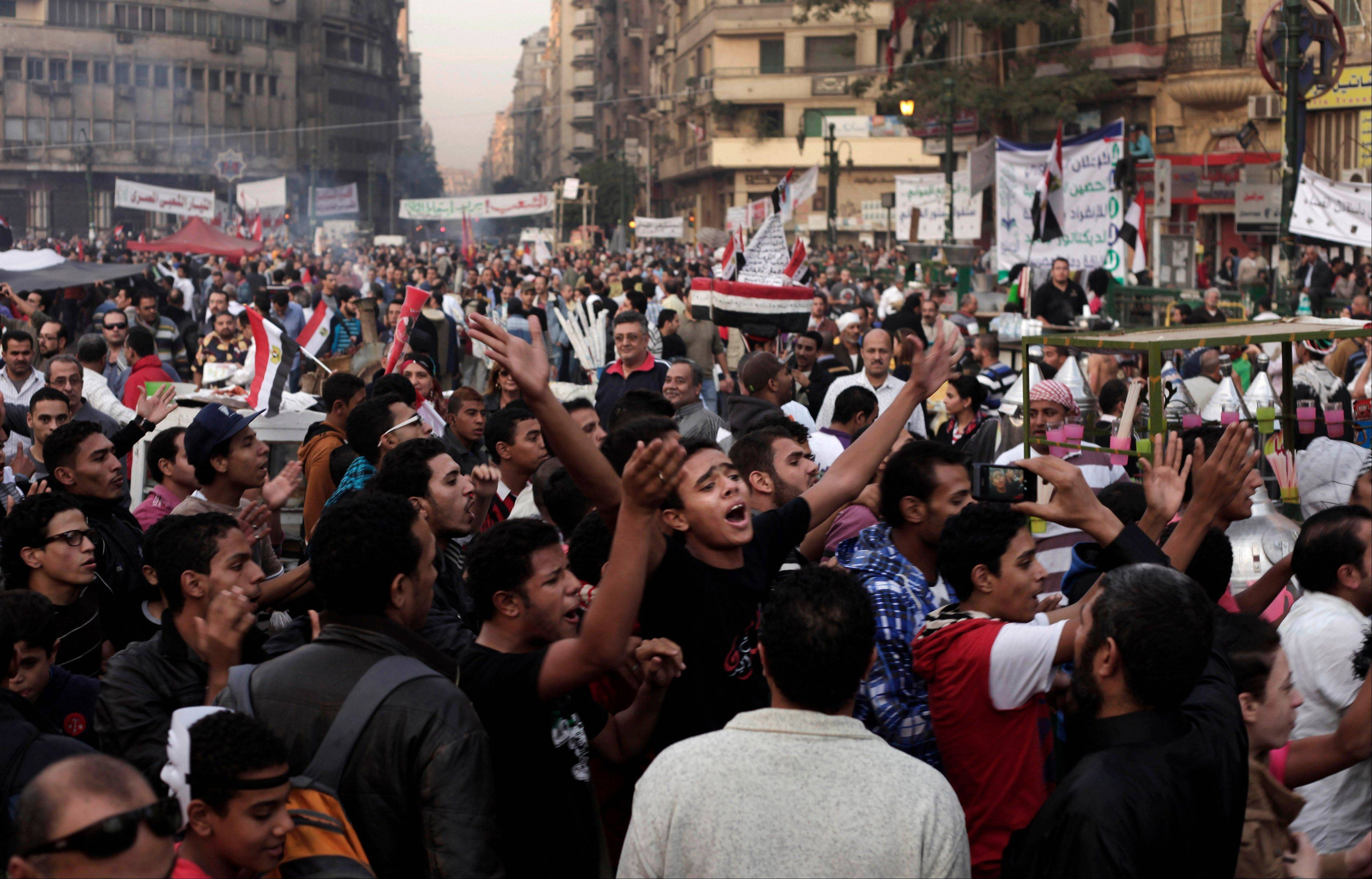 Egyptians chant slogans Friday during a demonstration in Tahrir Square, Cairo.