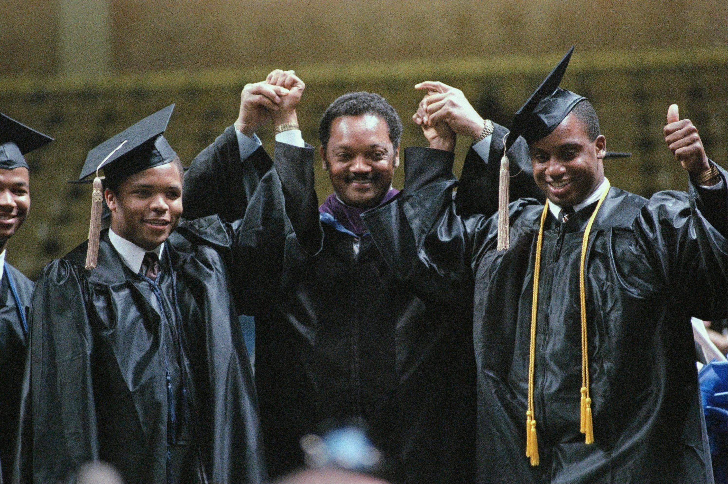 The Rev. Jesse Jackson poses with sons Jesse Jr., left, and Jonathan at the Greensboro Coliseum, after he gave the commencement address and his sons graduated from North Carolina A&T in 1988.