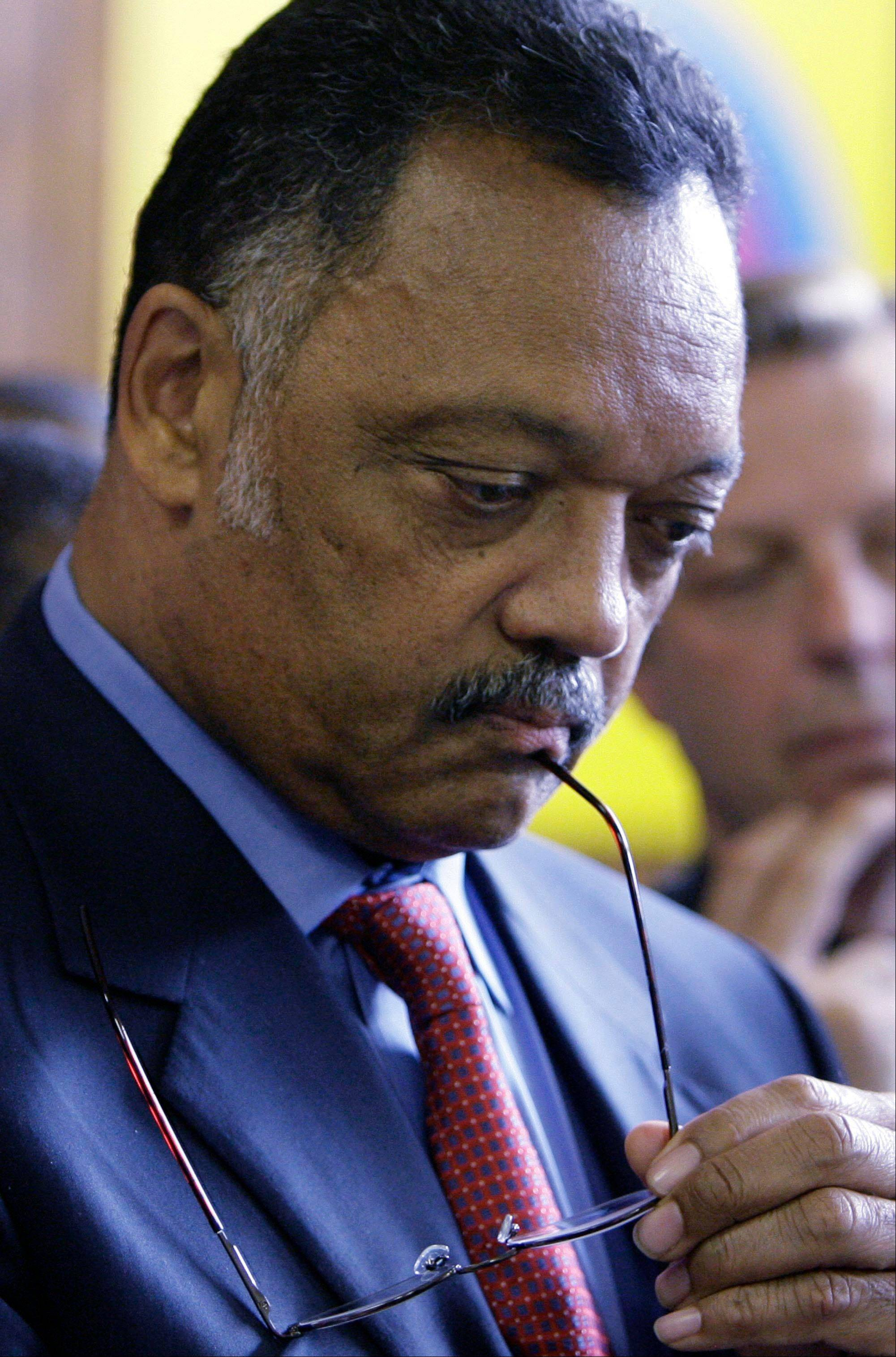 The Rev. Jesse Jackson listens to fellow speakers during a 2008 news conference at Rainbow PUSH headquarters in Chicago.