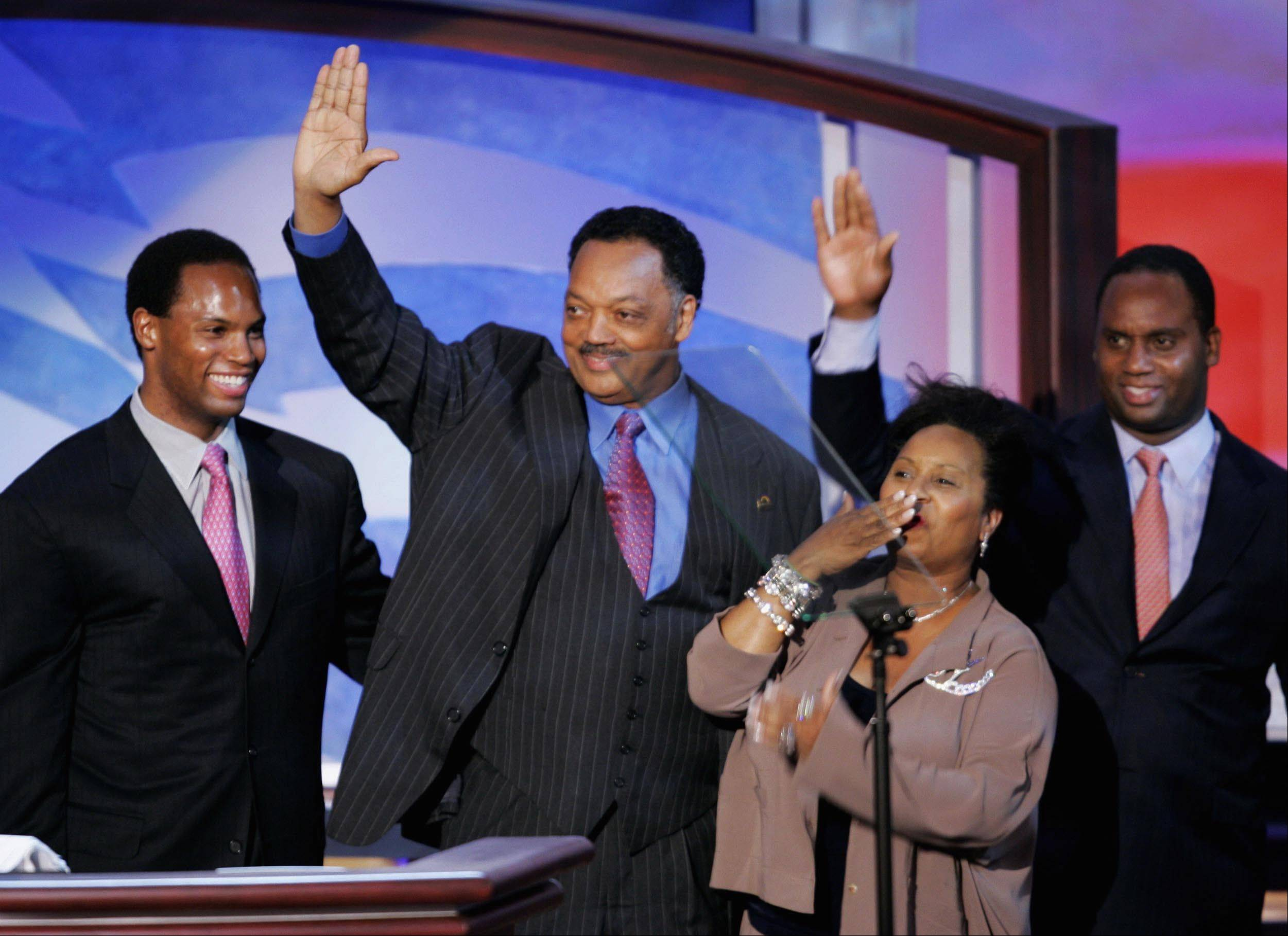 The Rev. Jesse Jackson is joined by his wife, Jacqueline, and sons Yusef, left, and Jonathan after he addressed the delegates to the 2004 Democratic National Convention in Boston.