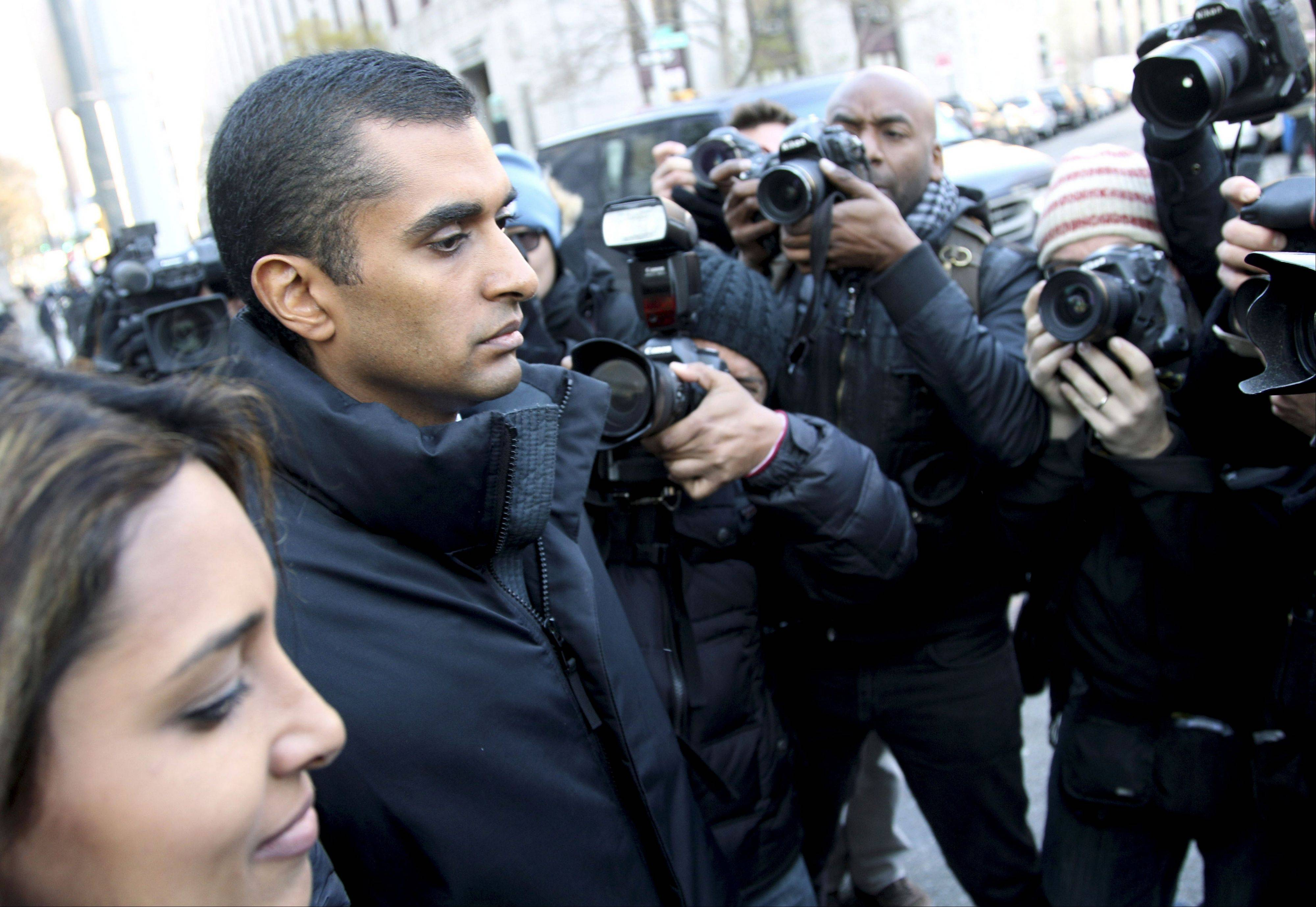 Mathew Martoma is surrounded by media as he leaves the federal courthouse Monday in New York.