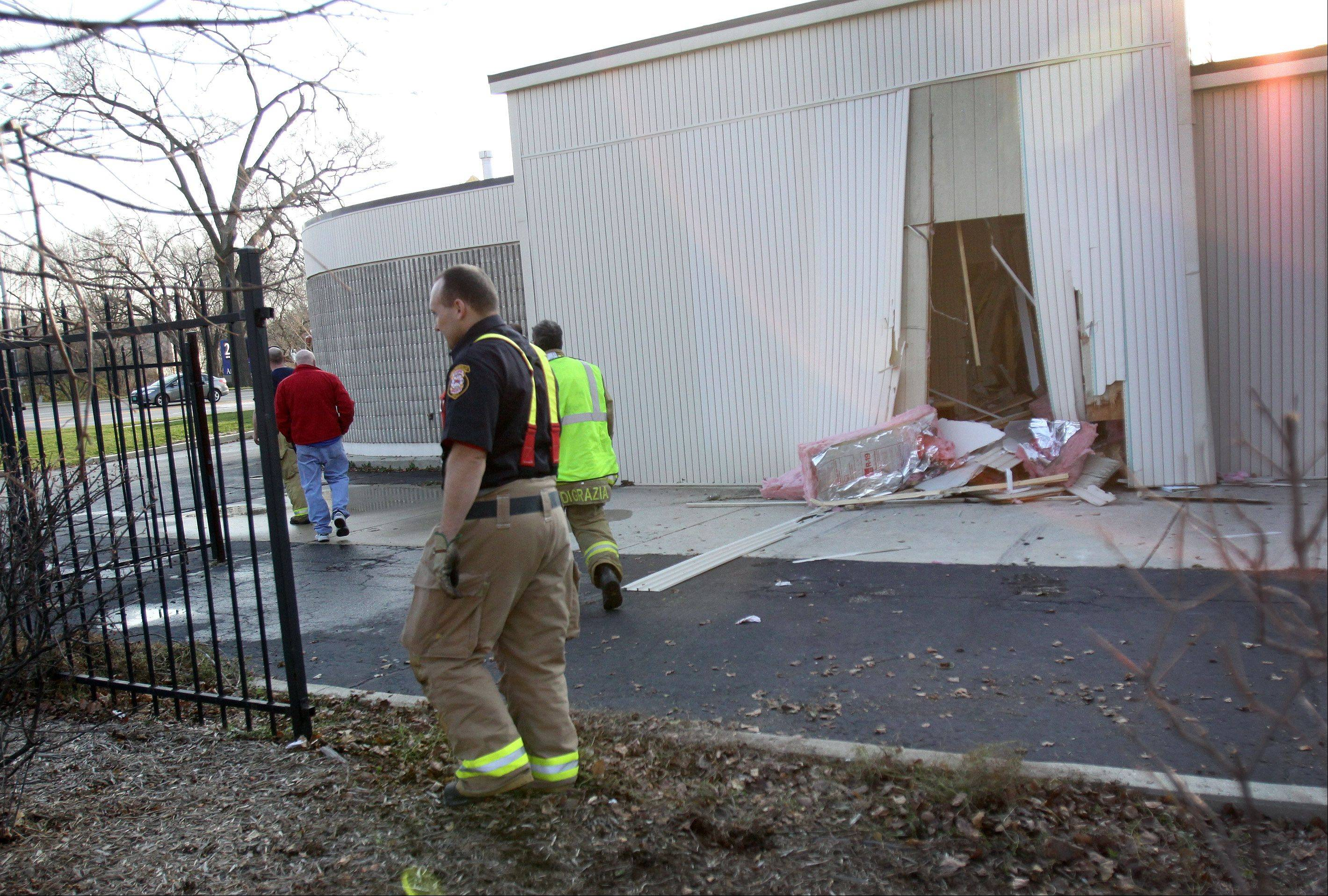 Firefighters estimate a car did about $50,000 to a Naperville eye care center Friday when it crashed through an exterior wall.