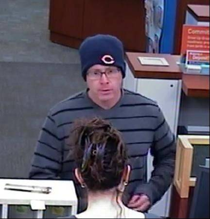 The FBI says a man seen robbing a Buffalo Grove bank in this surveillance image struck again Thursday in Oak Brook.