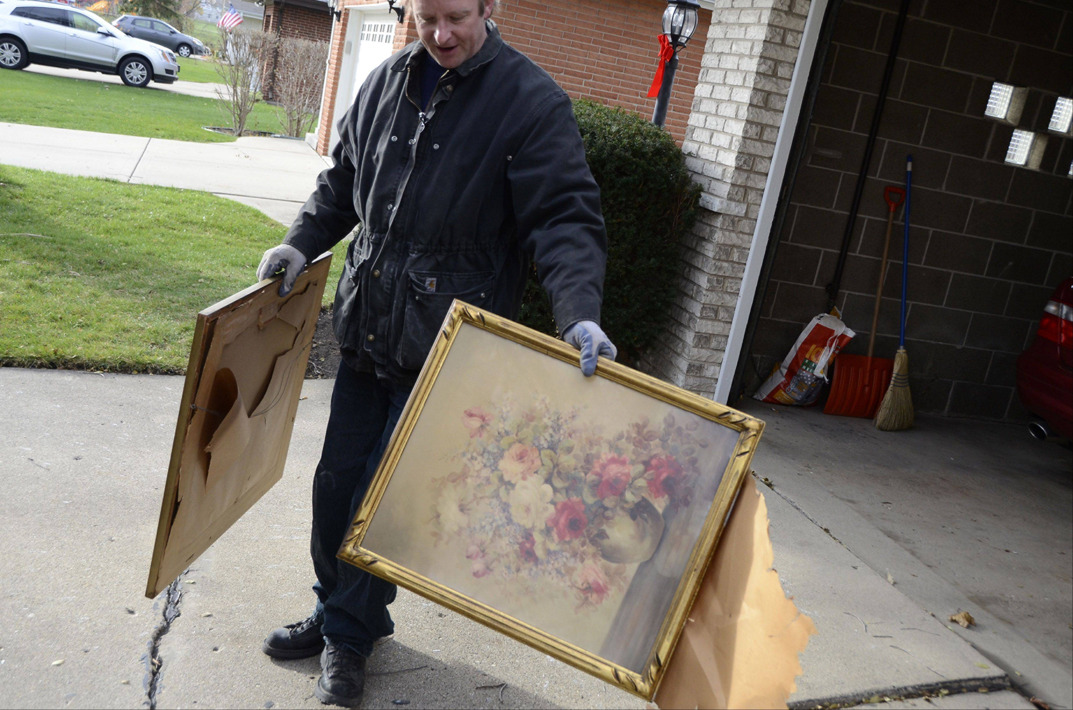 """Almost kind of nice, but … "" says Glen Hansen as he looks at a couple old pieces of art. ""I've got a lot of nice oil paintings on my walls that nobody wanted."" Both pieces ended up at the recycling center."