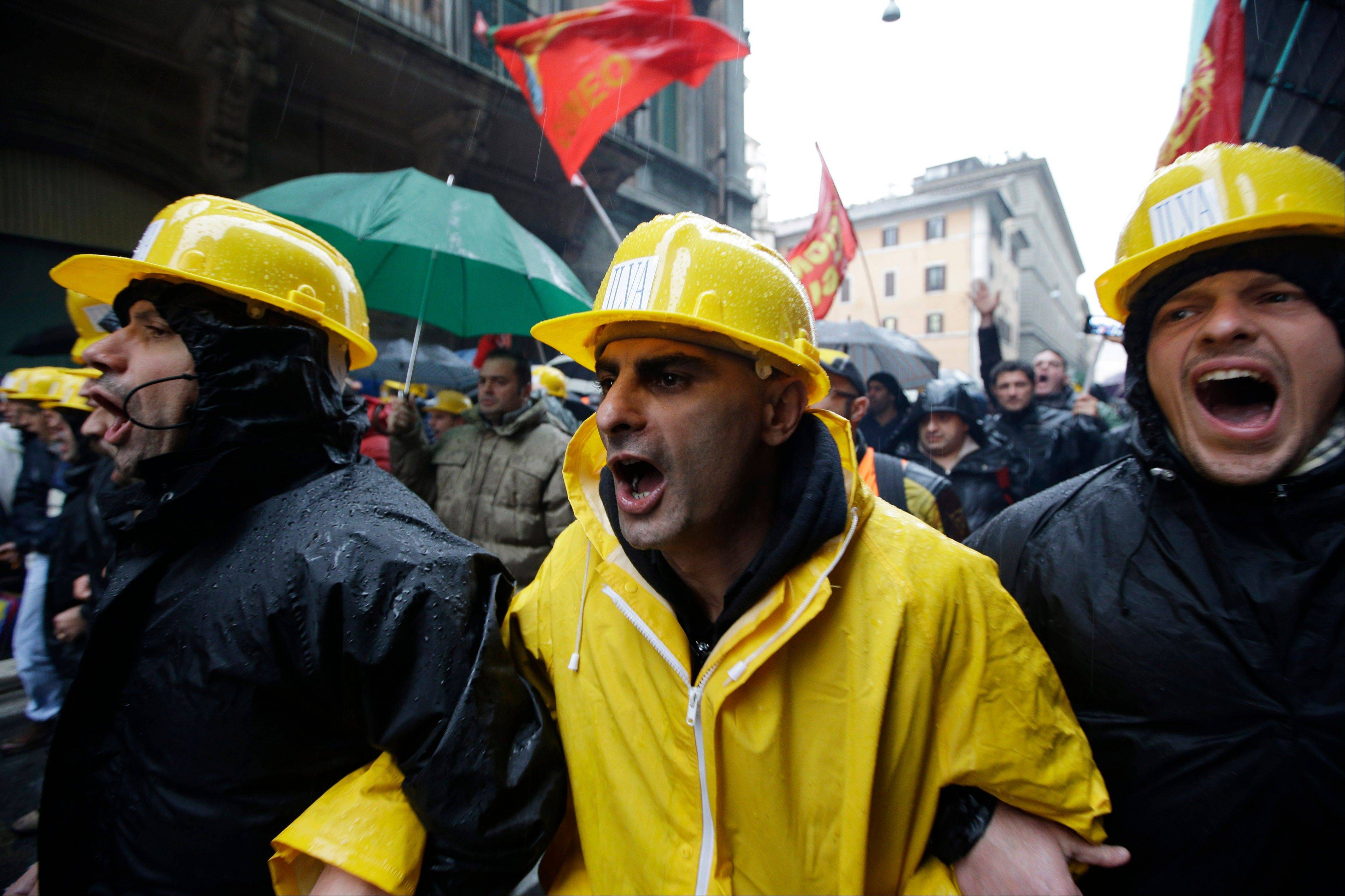 Ilva workers participate in a rally outside the Italian parliament, in Rome, Thursday, Nov. 29, 2012. Ilva, a steel plant in southern Italy at the center of an environmental scandal announced that it plans to close after police acting on prosecutors' warrants sequestered recent steel products bound for the market.