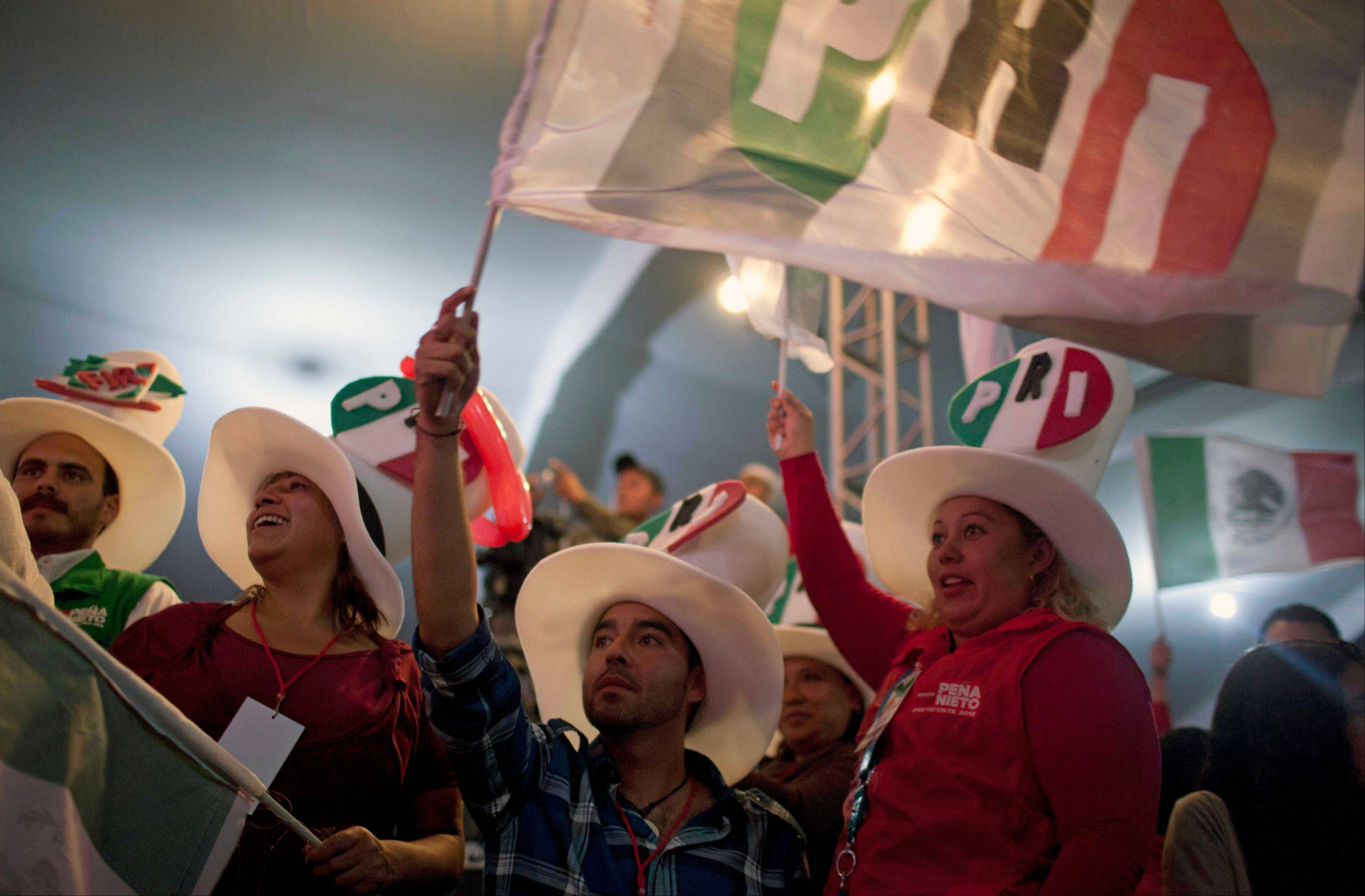 The Institutional Revolutionary Party, or PRI, reclaims the presidency Saturday, Dec. 1, 2012 after 12 years out of power, and President-elect Enrique Pena Nieto calls it a crowning moment of an effort to reform and modernize the party that ruled without interruption from 1929 to 2000.