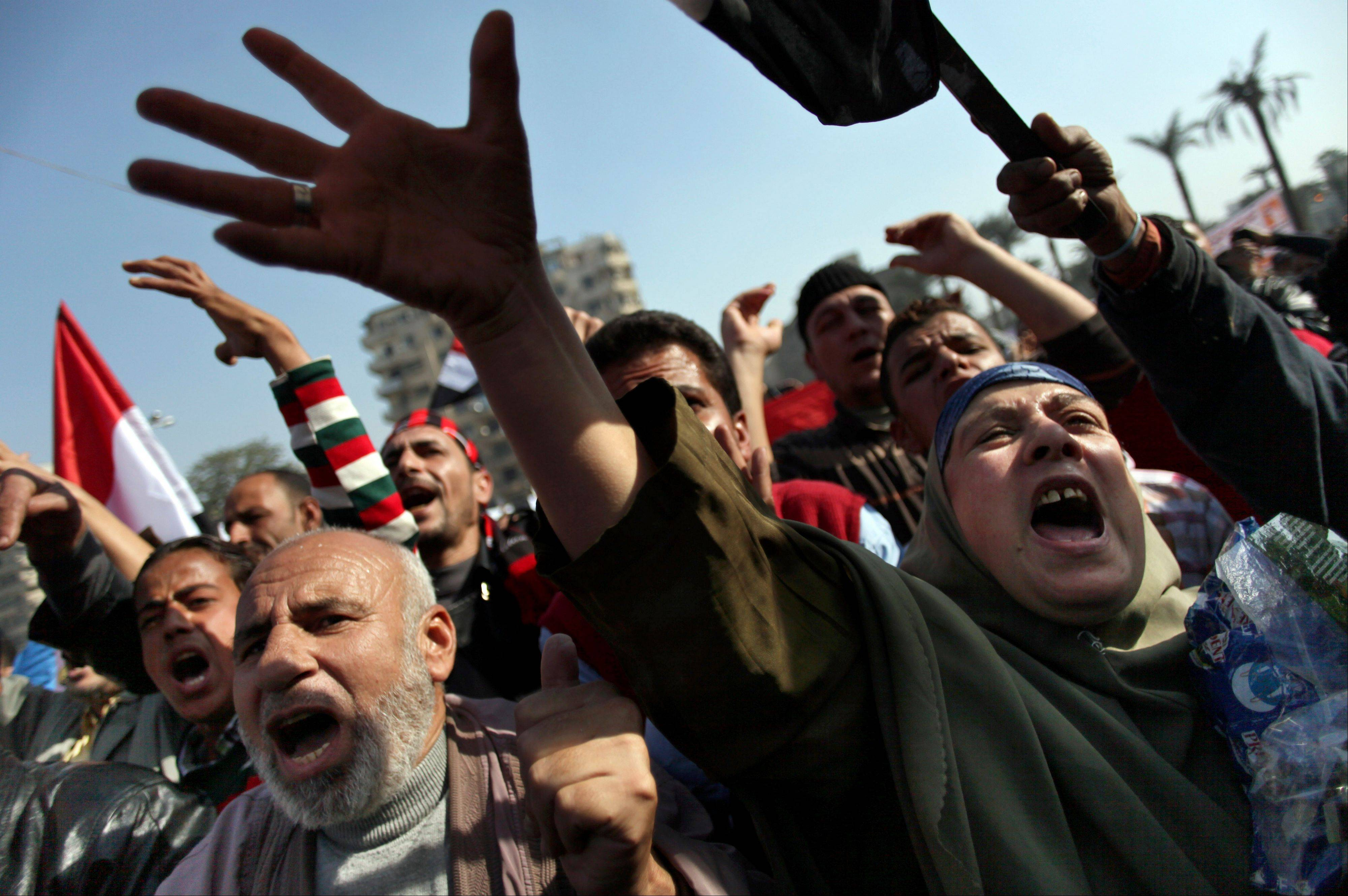 Egyptian protesters chant anti-Muslim Brotherhood slogans as they attend a rally in Tahrir Square, in Cairo, Egypt, Friday, Nov. 30, 2012.