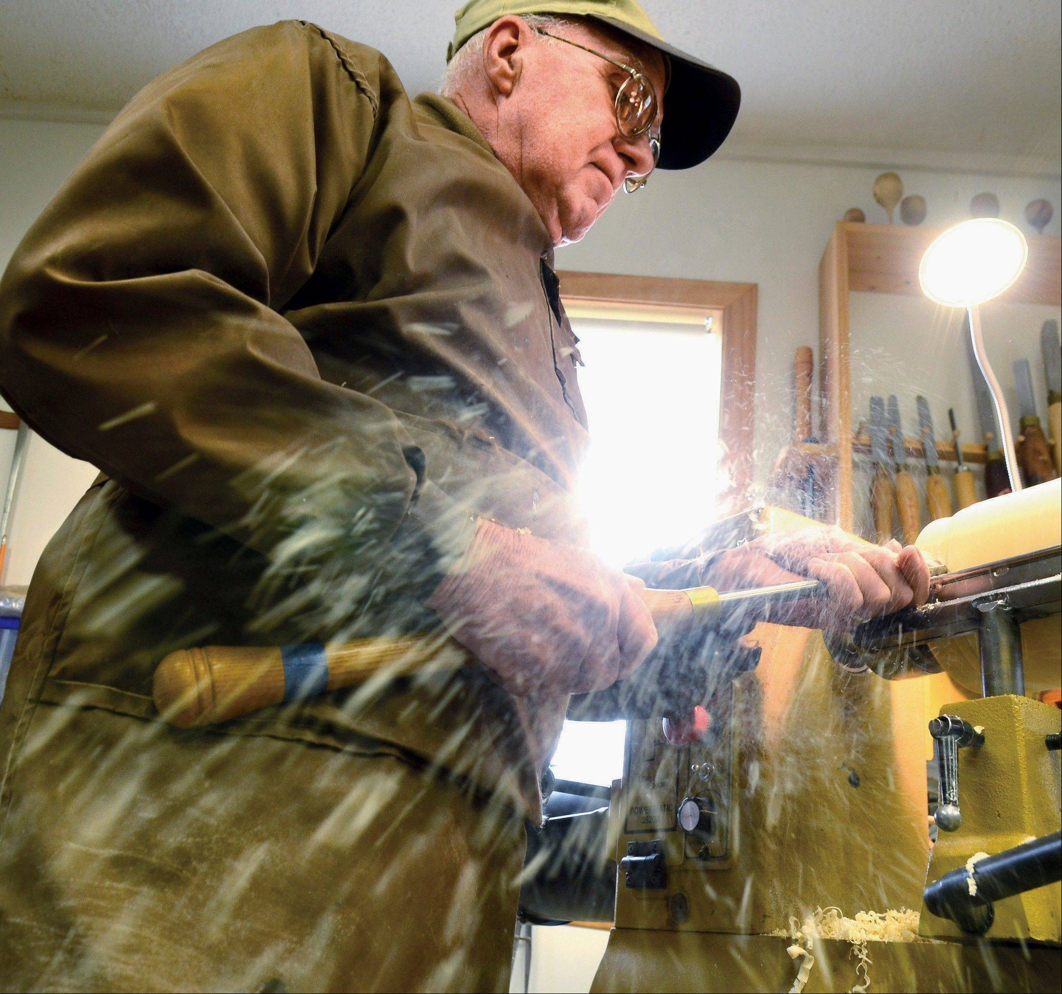 Lloyd Beckman, 68, turns a piece of wood on a lathe at his Sterling, home.