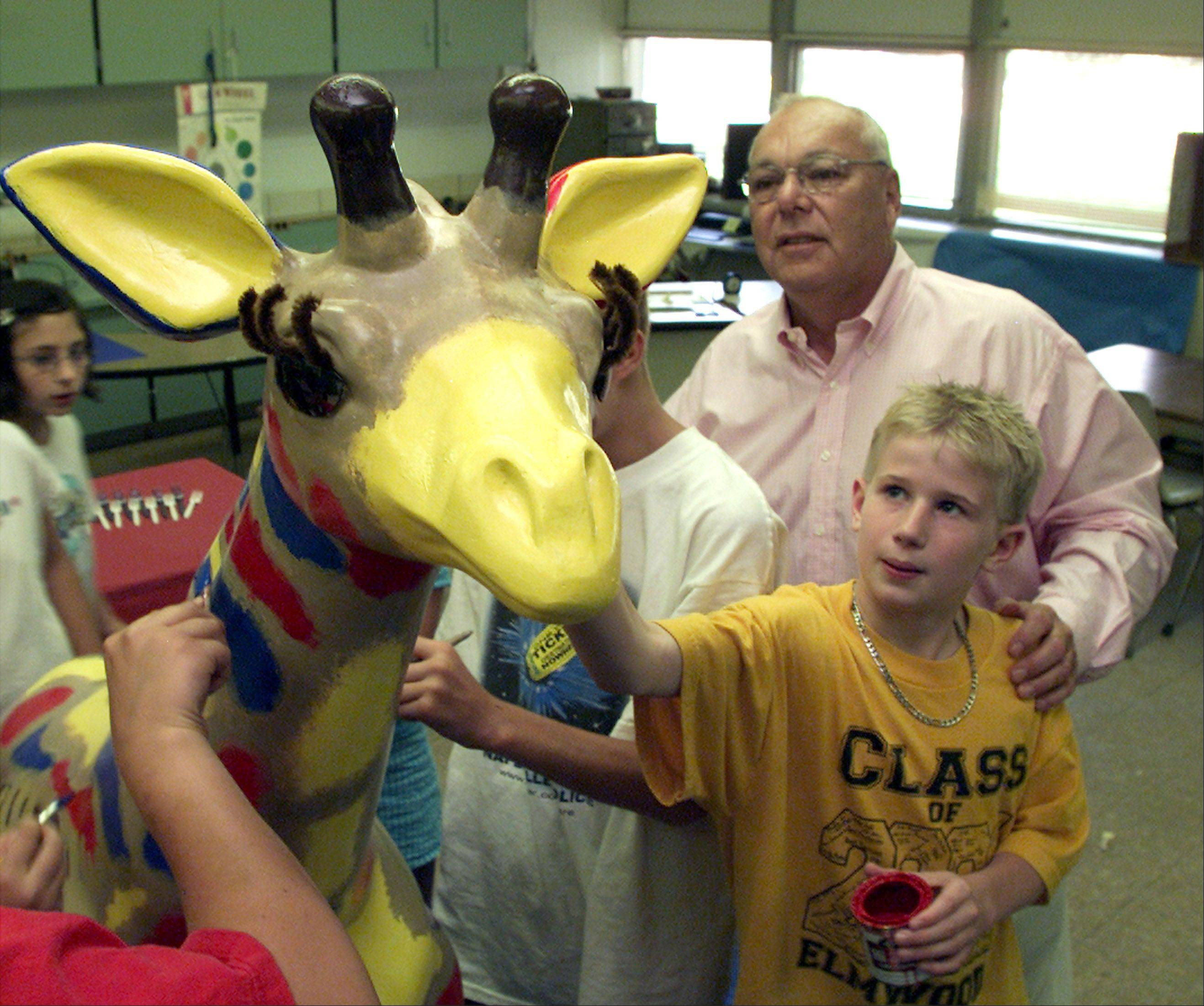 Prominent Naperville attorney Bill Brestal was active in civic affairs. Here, he works with children decorating a giraffe -- part of a United Way fundraising effort.