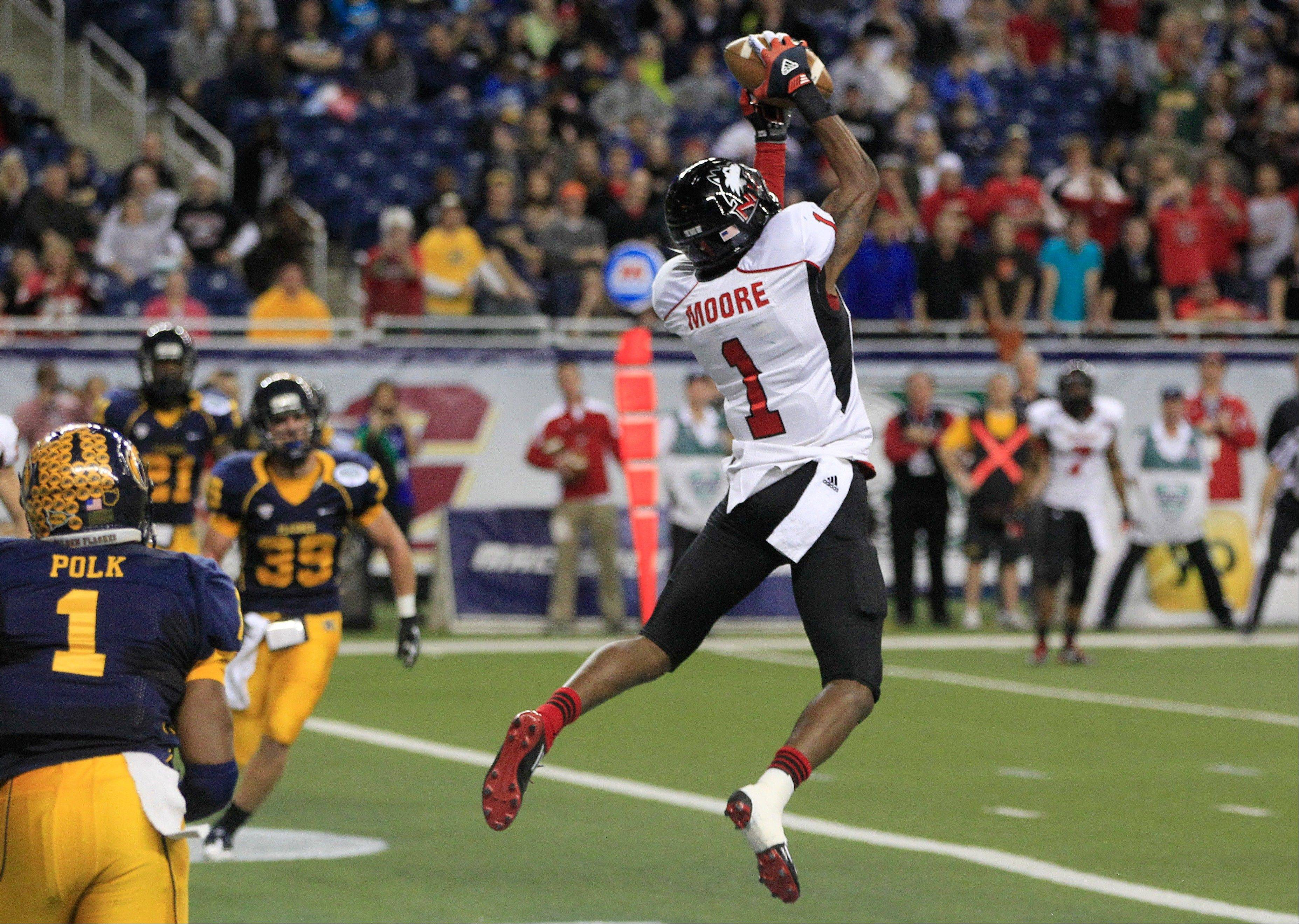 Northern Illinois wide receiver Martel Moore (1) catches a pass for a touchdown Friday during the second quarter.