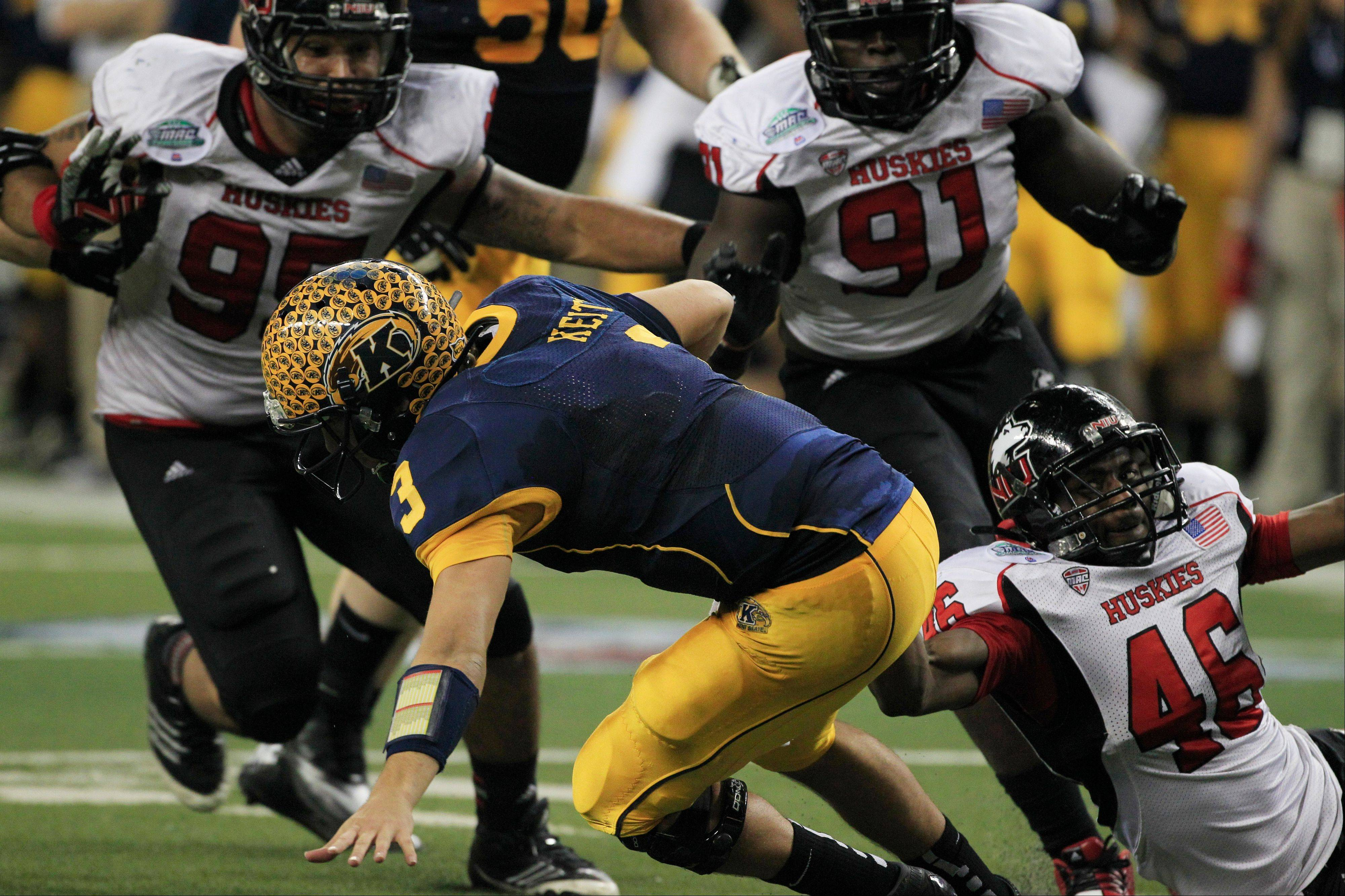 Kent State quarterback Spencer Keith is sacked by Northern Illinois defensive end George Rainey (46) Friday during the third quarter.