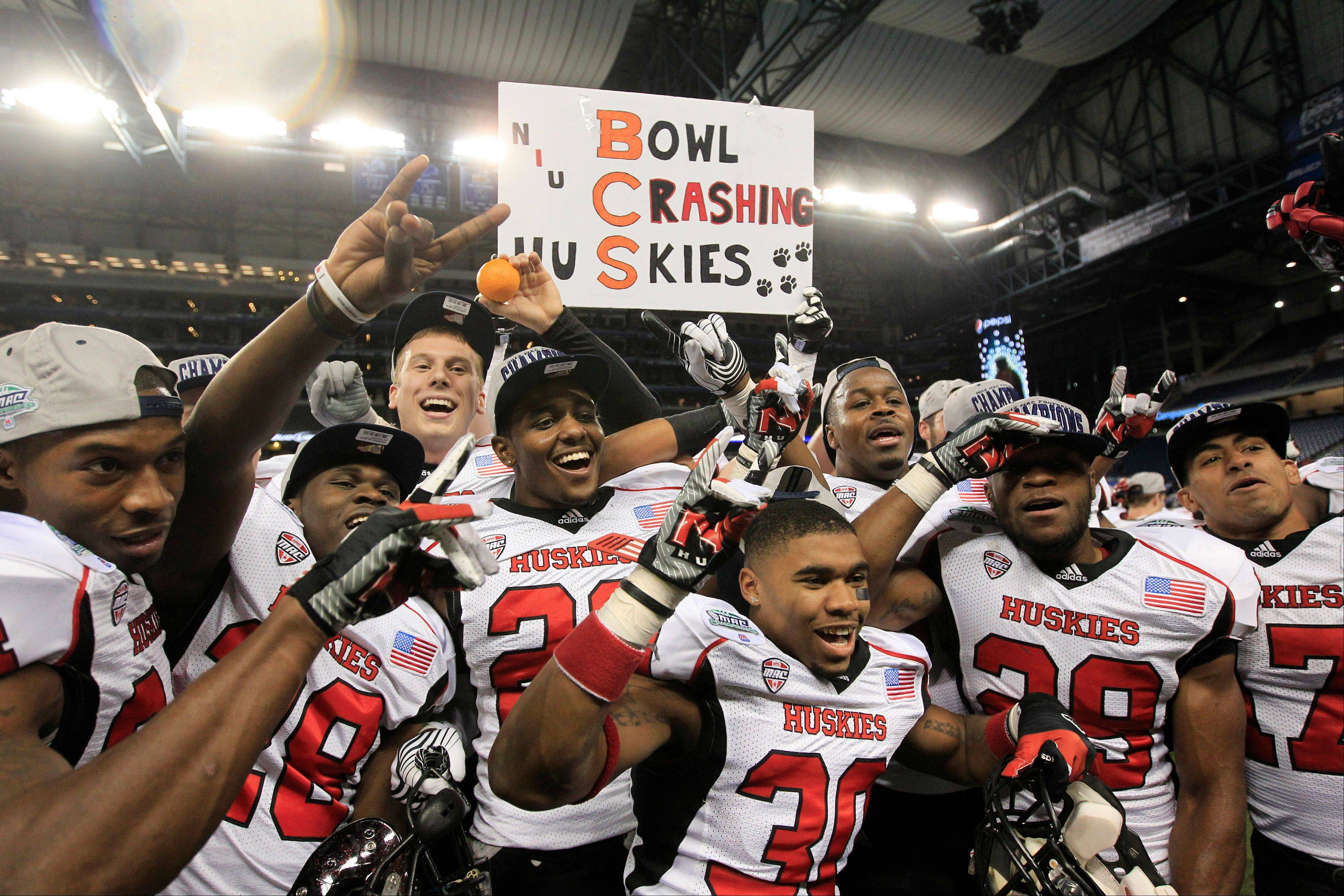 The Northern Illinois team poses for photographers Friday after defeating Kent State 44-37 in double overtime.