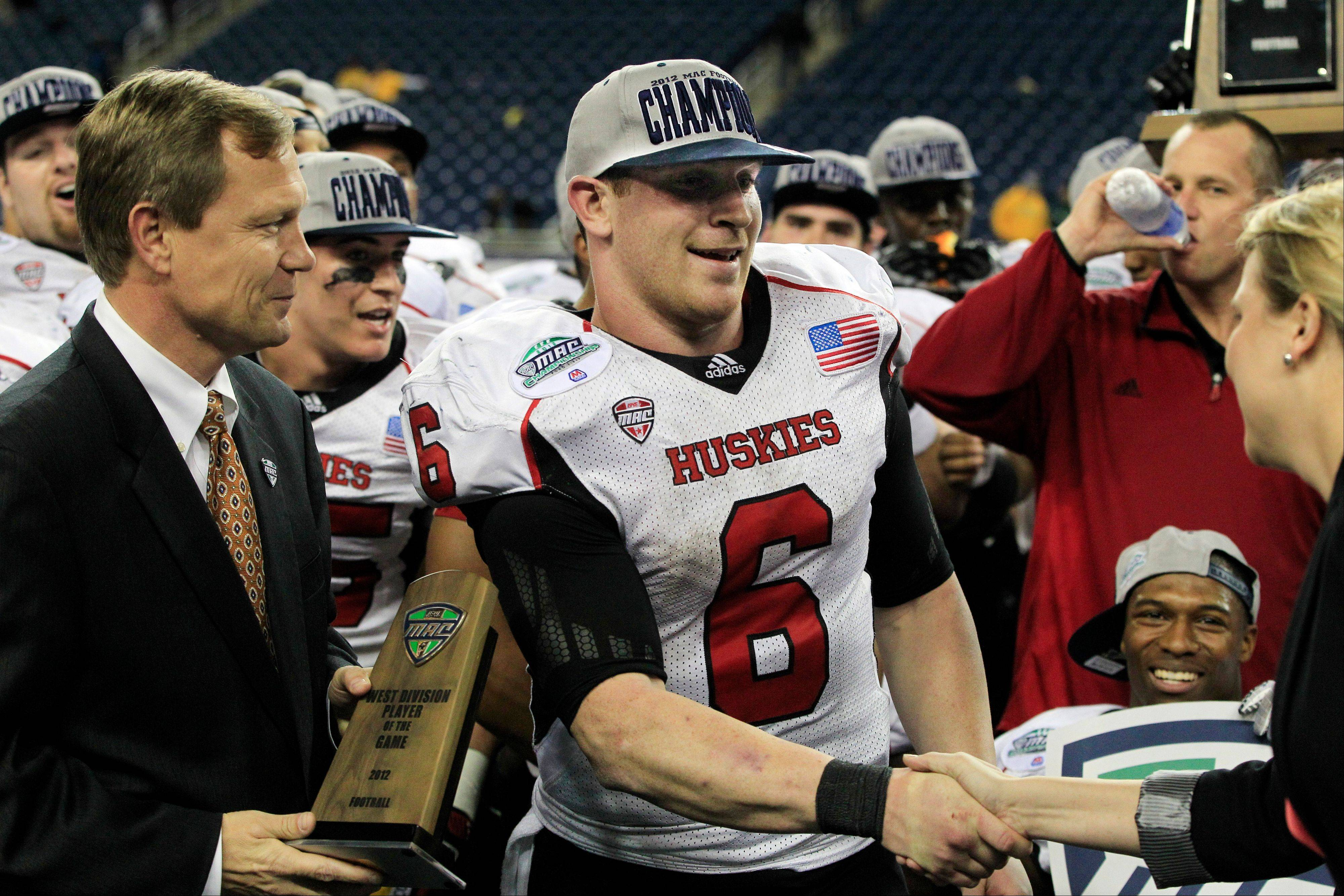 Northern Illinois quarterback Jordan Lynch (6) receives the most valuable player award Friday after the Huskies defeated Kent State 44-37 in double overtime.