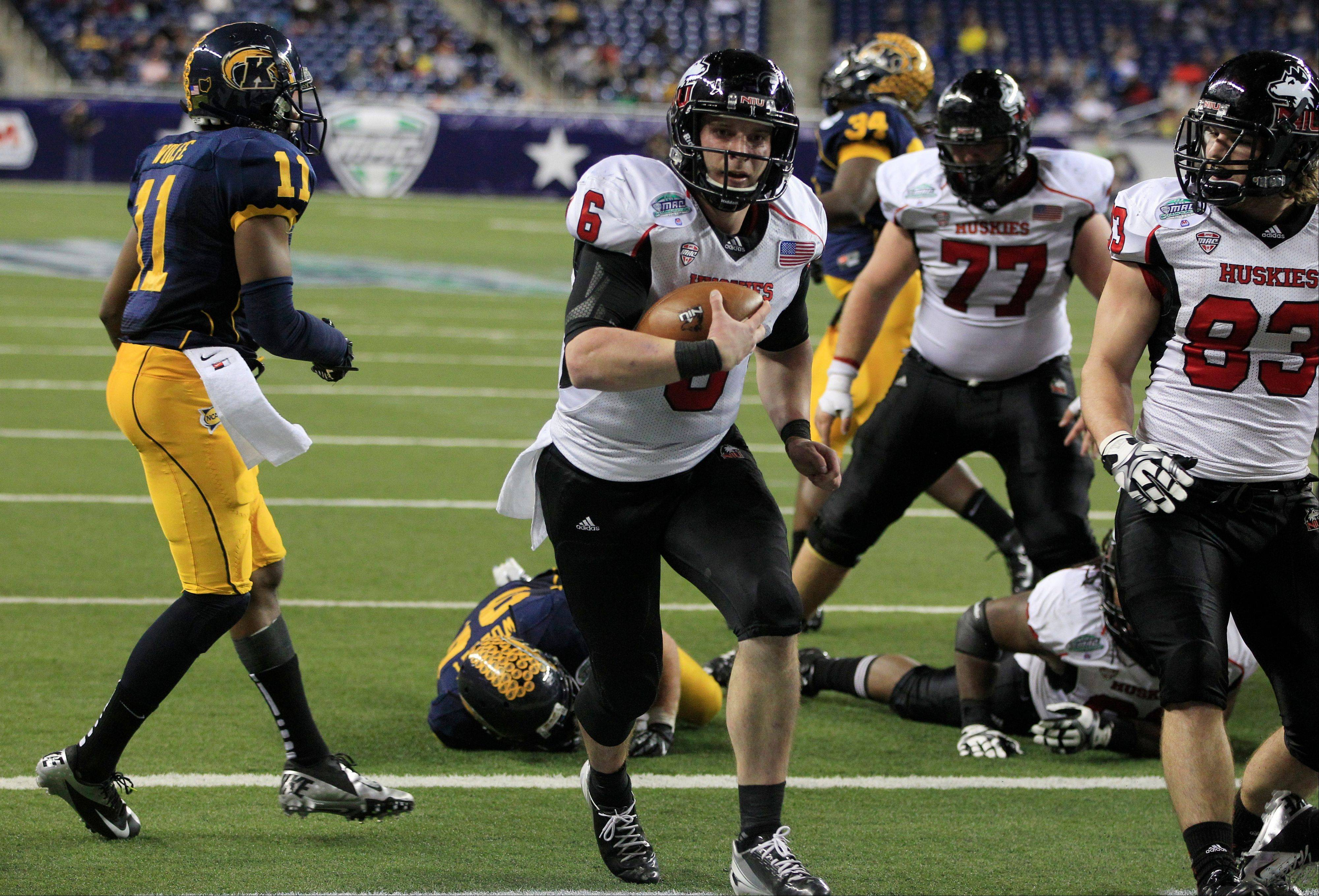 Northern Illinois quarterback Jordan Lynch scores on a 1-yard run Friday during the third quarter of the Mid-American Conference championship game against Kent State in Detroit.