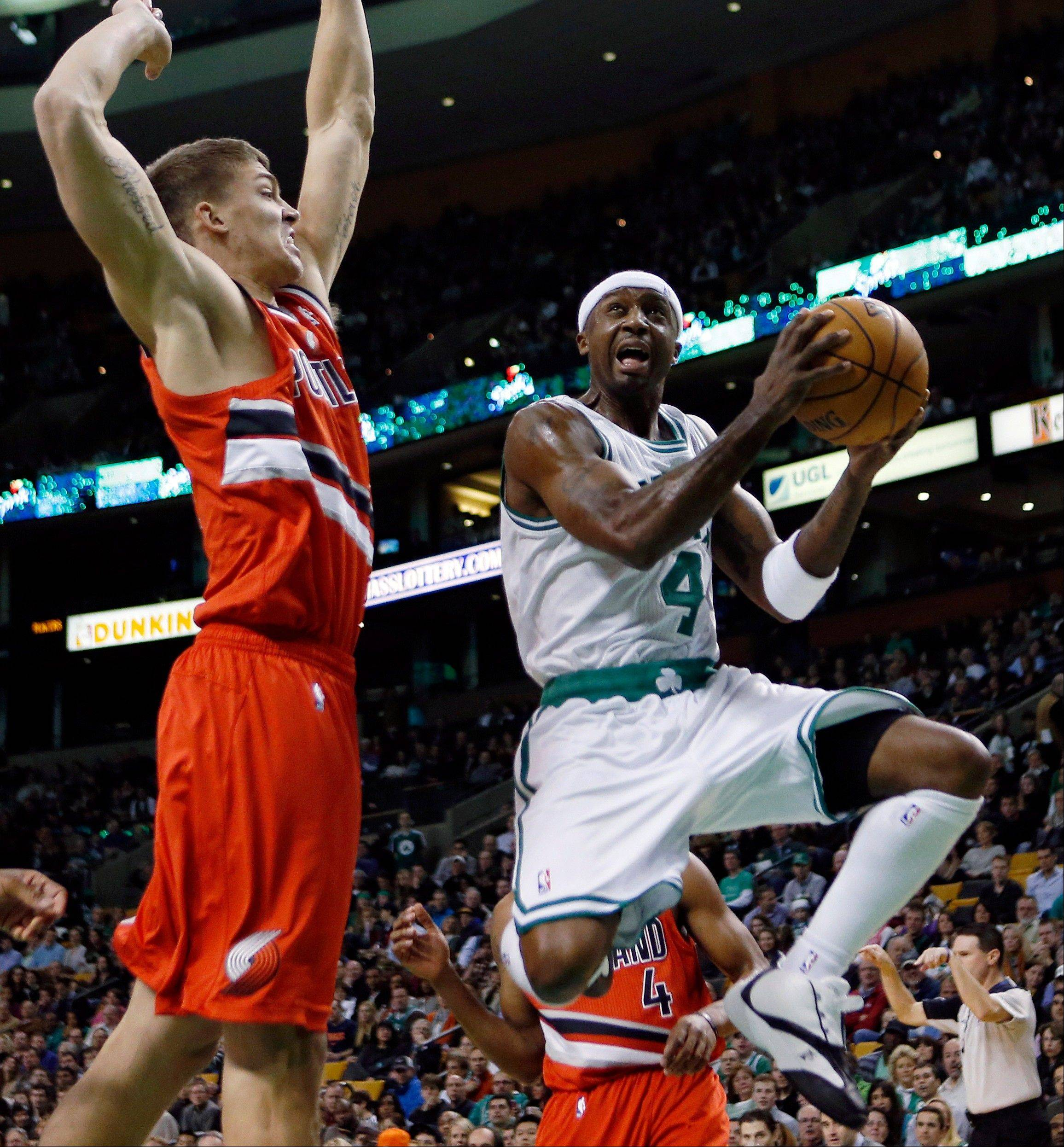 Boston Celtics guard Jason Terry looks to shot against Portland Trail Blazers center Meyers Leonard Friday during the first quarter in Boston.