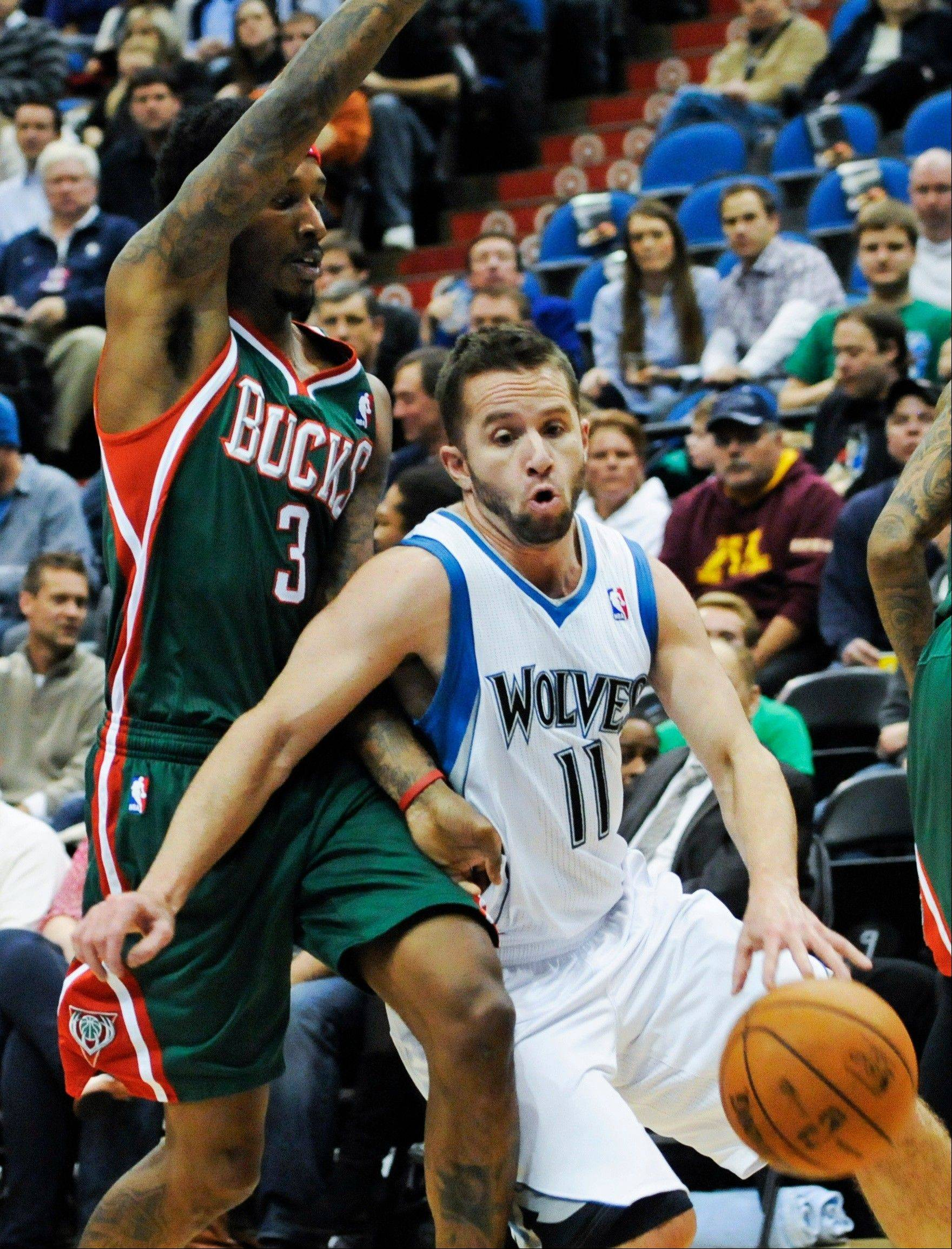Minnesota Timberwolves guard J.J. Barea, right, tries to drive around Milwaukee Bucks' Brandon Jennings Friday during the first half in Minneapolis.