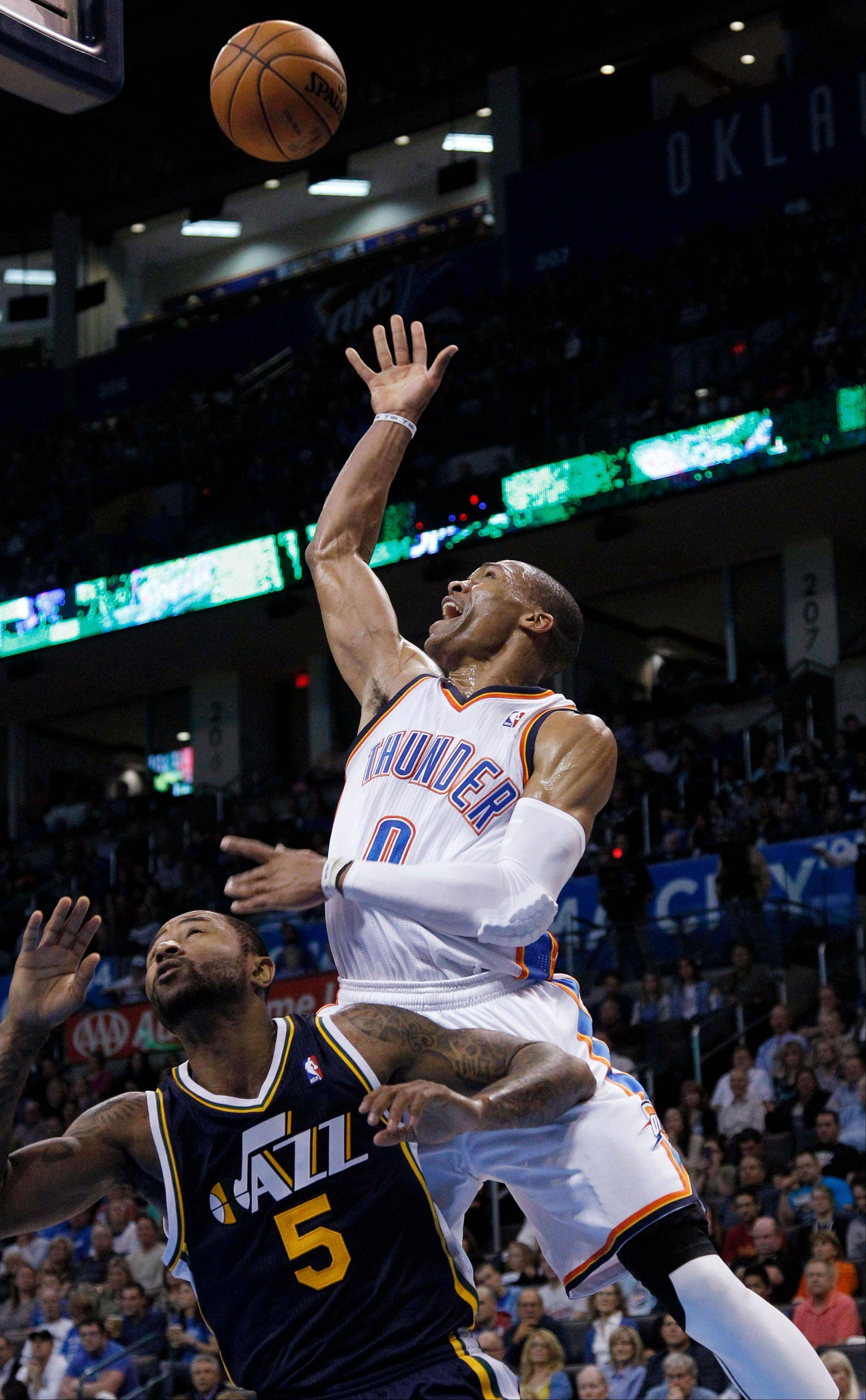 Oklahoma City Thunder guard Russell Westbrook releases a shot over Utah Jazz guard Mo Williams Friday during the second quarter in Oklahoma City.