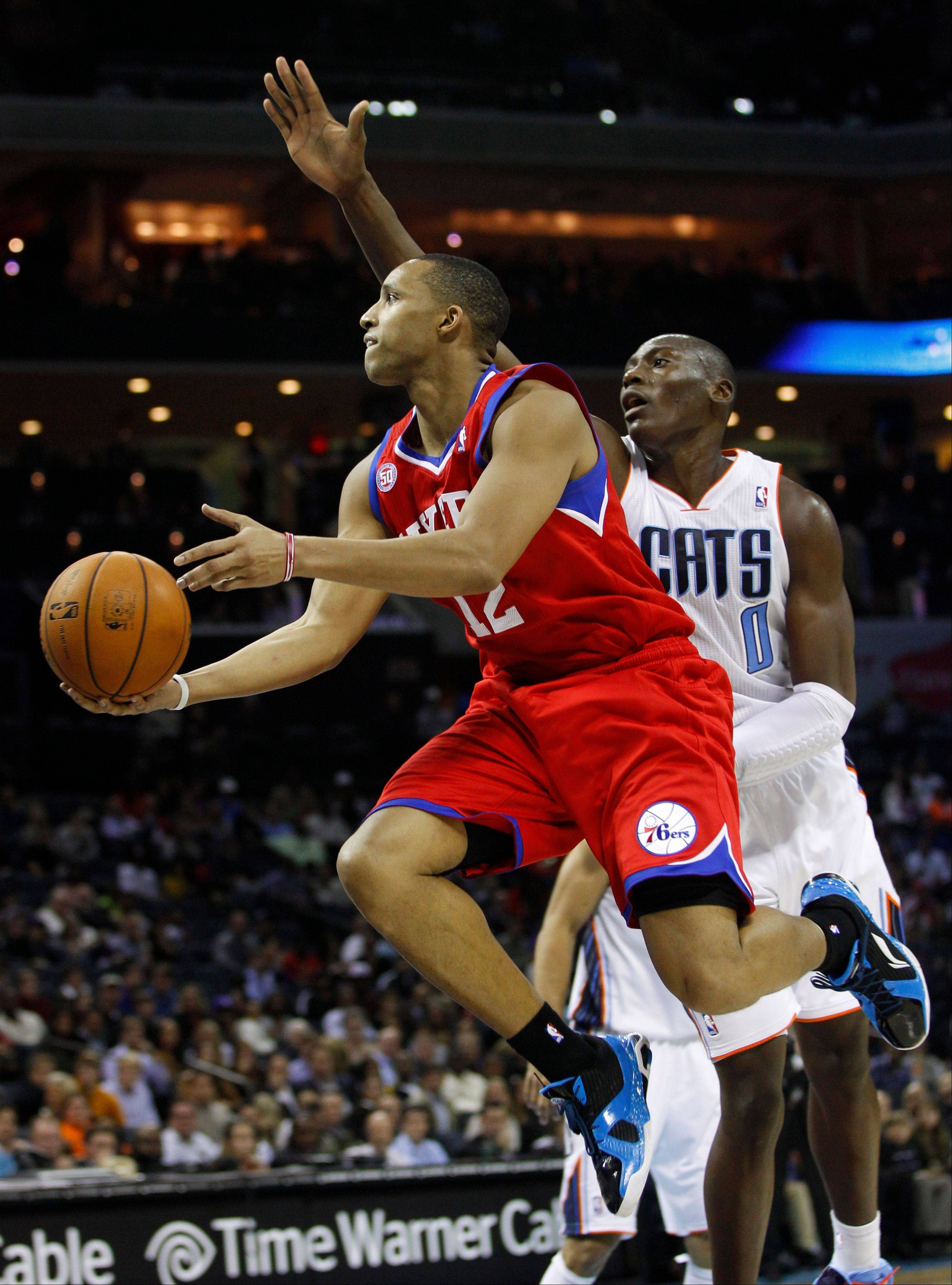 The Philadelphia 76ers' Evan Turner drives past the Charlotte Bobcats' Bismack Biyombo Friday during the second half in Charlotte, N.C. Philadelphia won 104-98.
