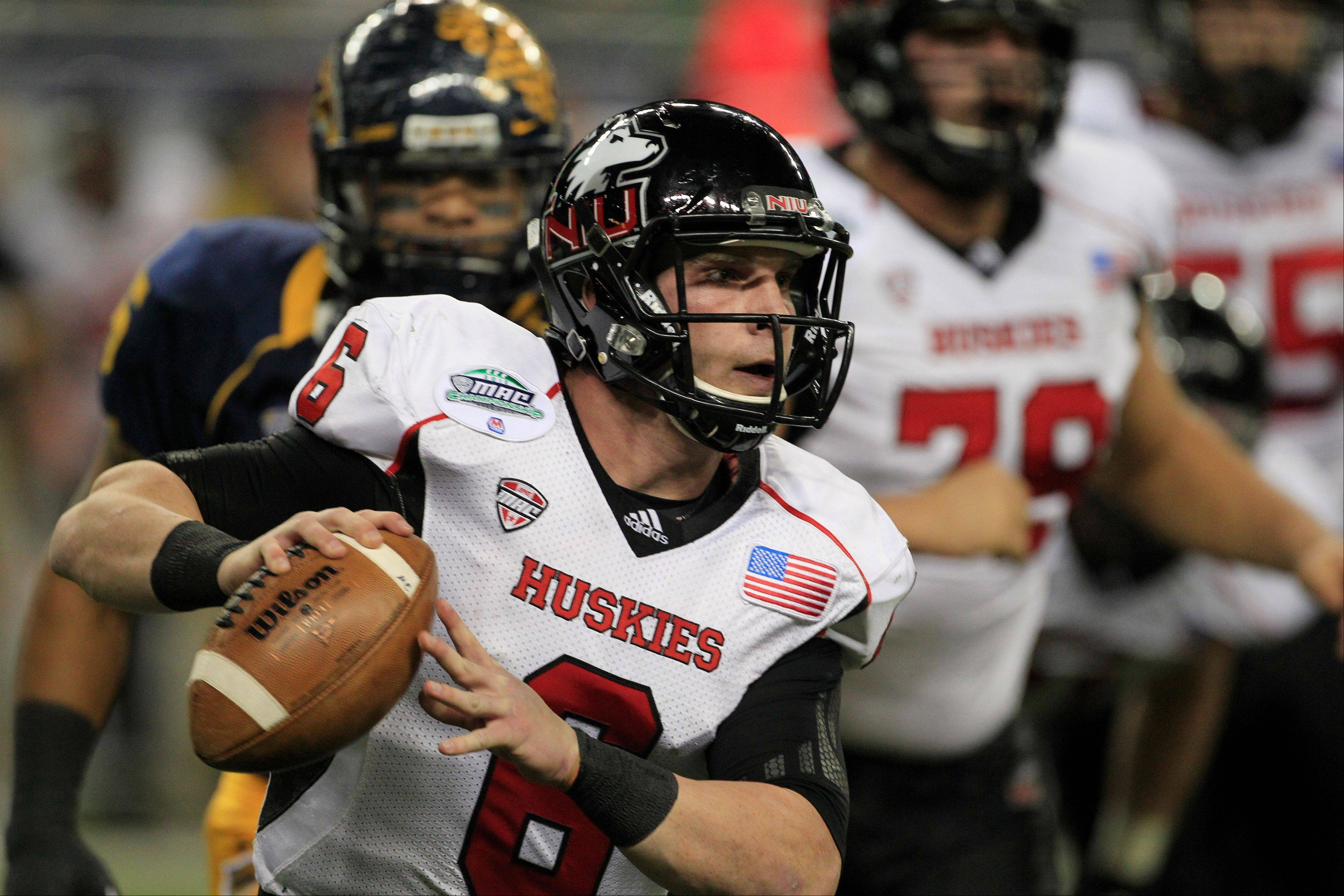 Northern Illinois quarterback Jordan Lynch scrambles Friday during the first quarter of the Mid-American Conference championship against Kent State in Detroit.