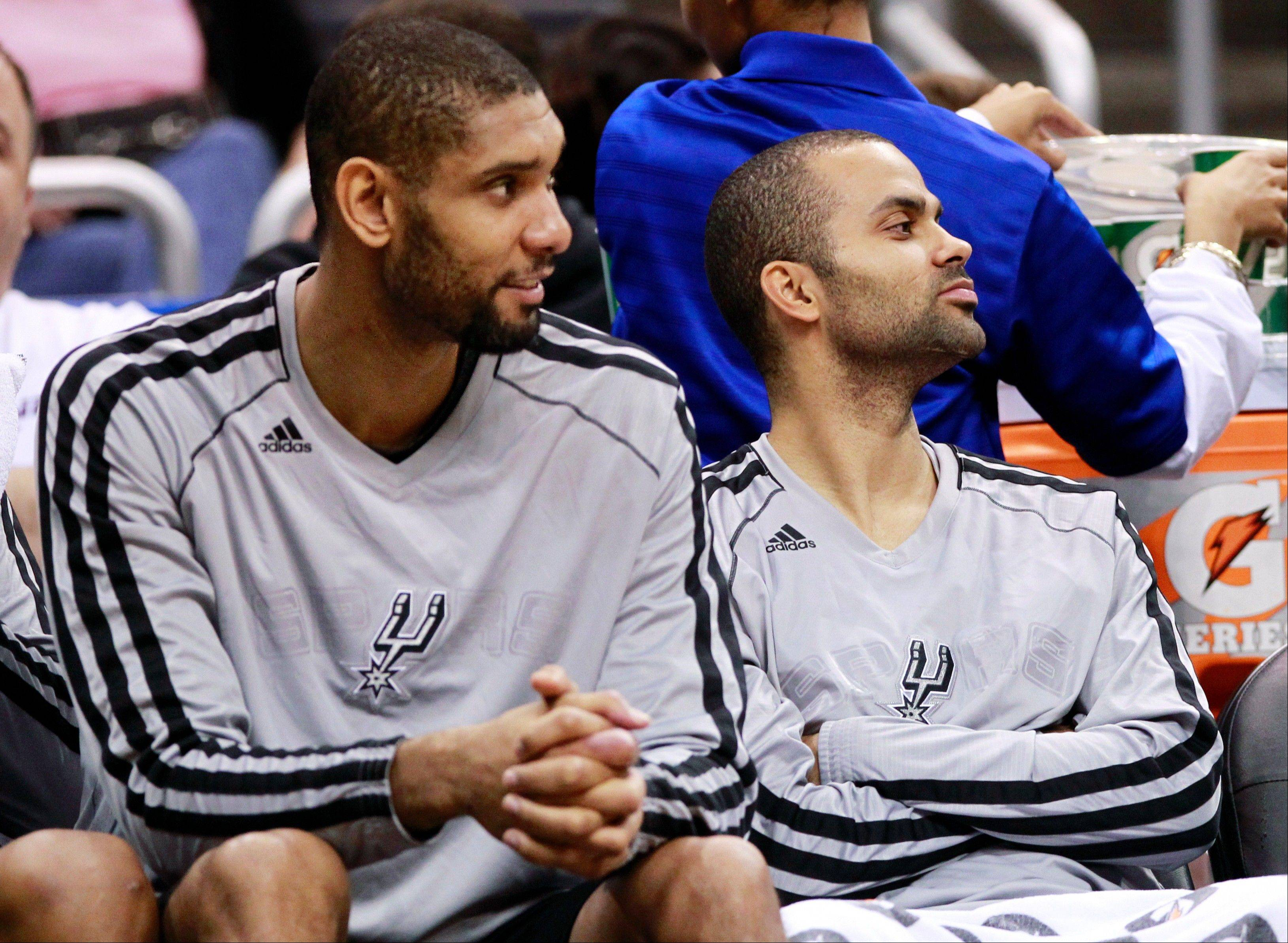 "Tim Duncan, left, and Tony Parker were two of four Spurs players who did not play in San Antonio's game against Miami on Thursday night. They were all sent back to San Antonio by coach Gregg Popovich, who said the move was in his team's best interest. NBA Commissioner David Stern called the decision ""unacceptable,"" apologizing to fans."