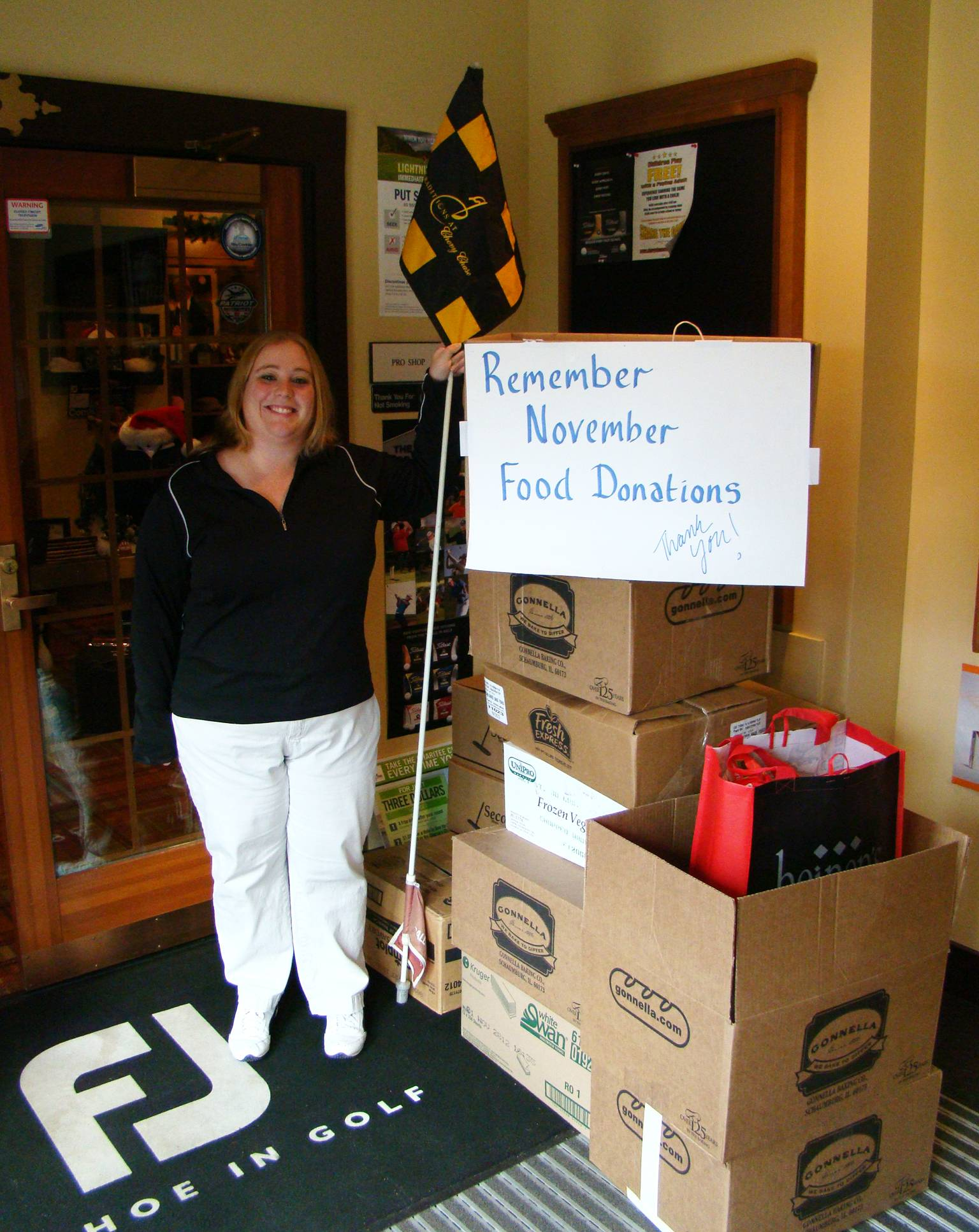 "Wheeling Park District employee Jessica Lang accepts donations for the ""Remember November"" food drive."