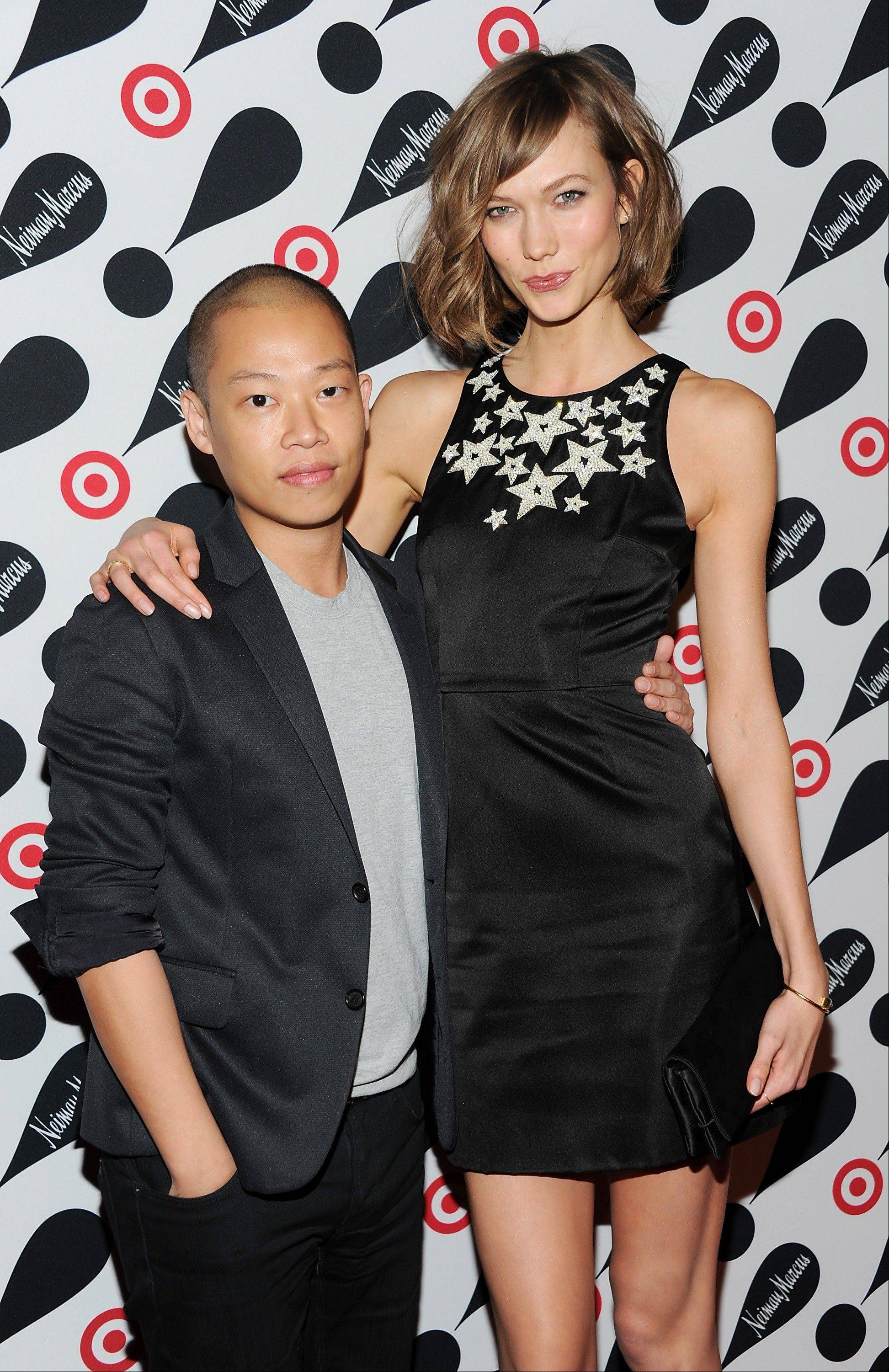 Designer Jason Wu and model Karlie Kloss attend the Target and Neiman Marcus holiday collection launch in New York.